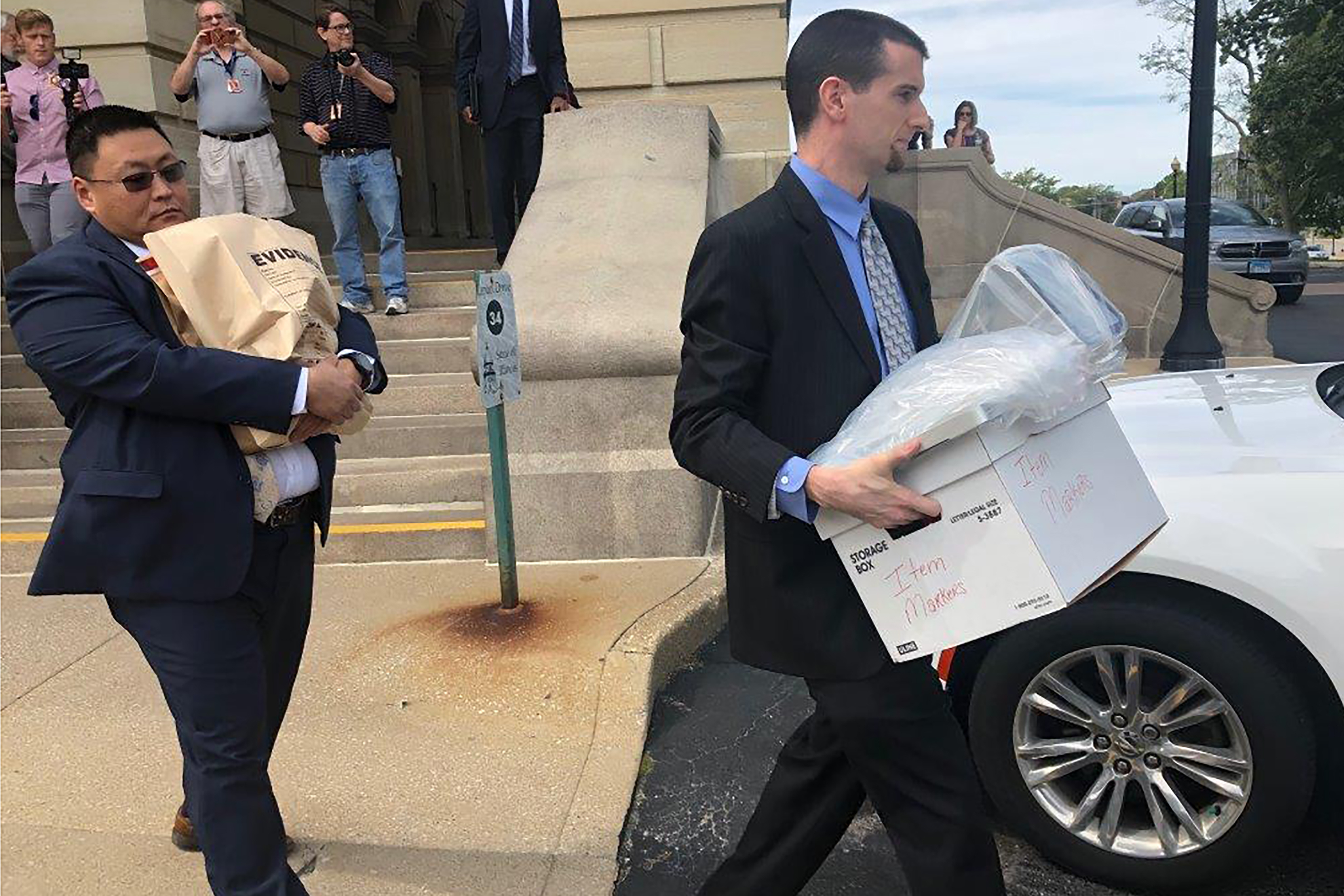 photo of men carrying evidence boxes