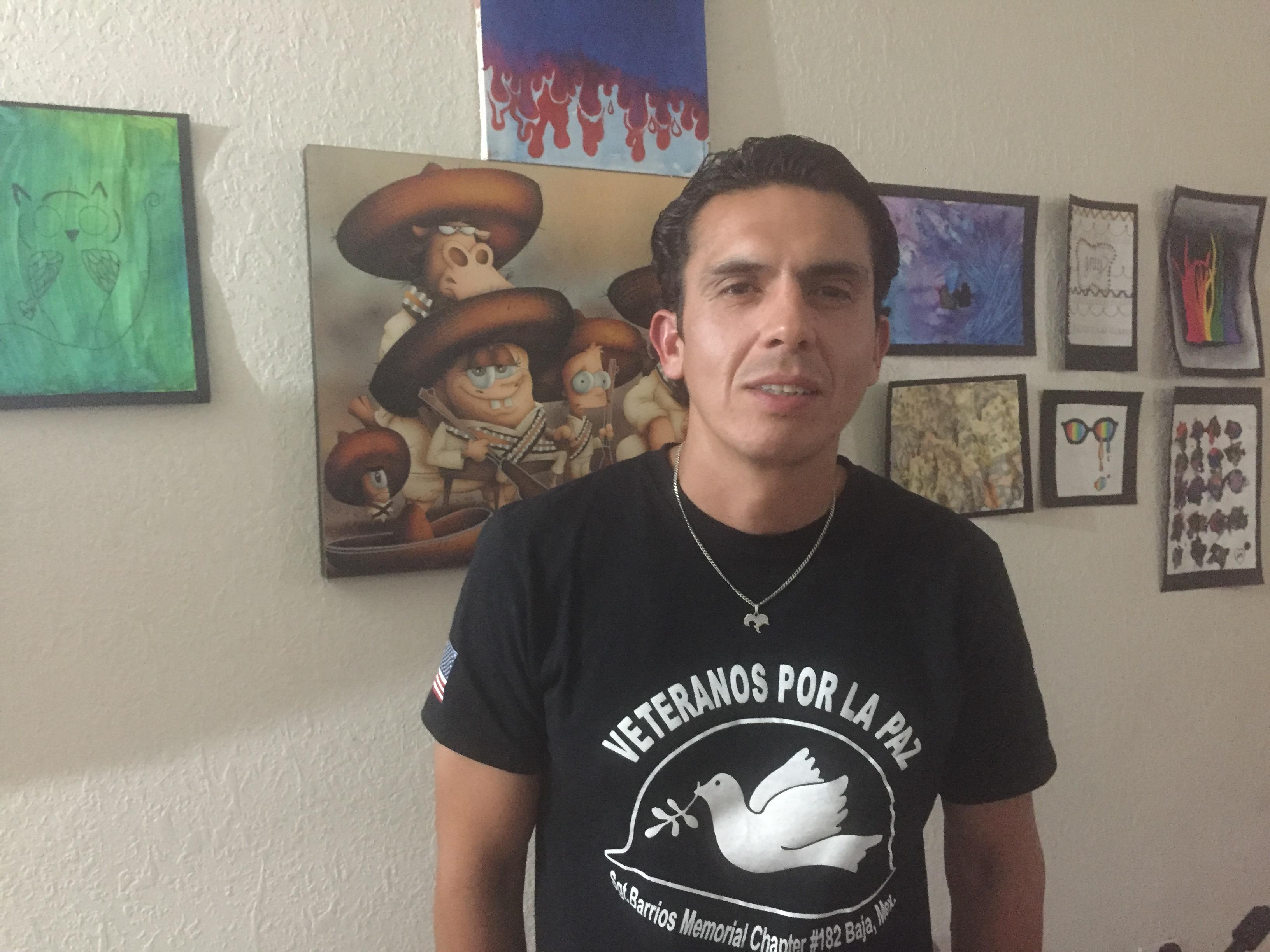 Deported veteran Alex Murillo inside his apartment in Ensenada, Mexico.