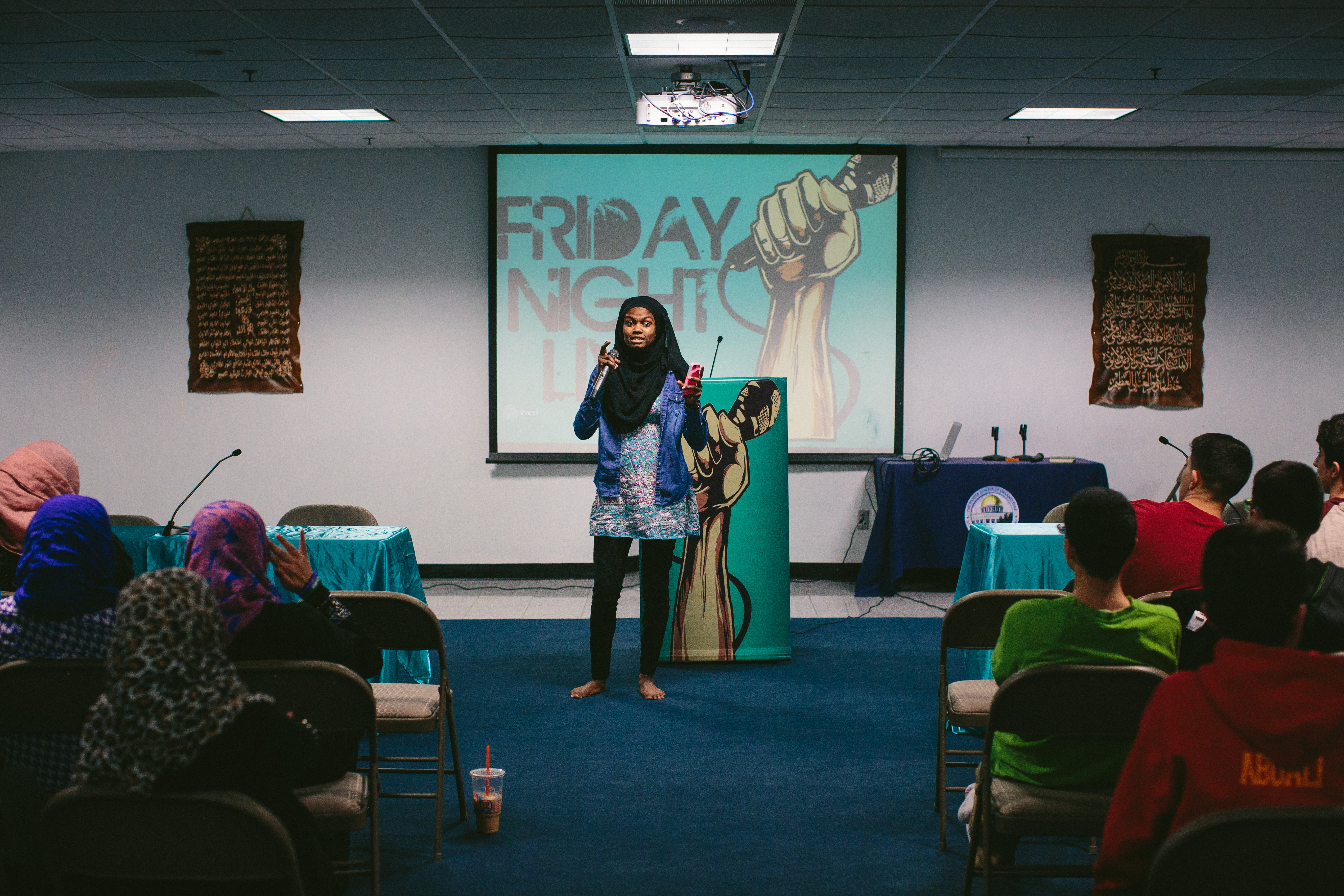 Aanisah Mubarak, 20, speaks to other Muslim youths during Friday Night Live, a youth group that gathers at The Prayer Center of Orland Park. (Alyssa Schukar/For WBEZ)
