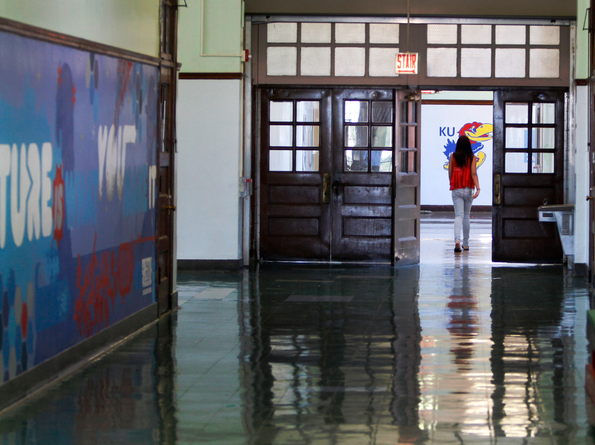 A lone student walks down a hallway at the Jean de Lafayette Elementary School on the final day of school in 2013. Lafayette was one of the 50 schools closed by Chicago Public Schools. (AP Photo/Scott Eisen)