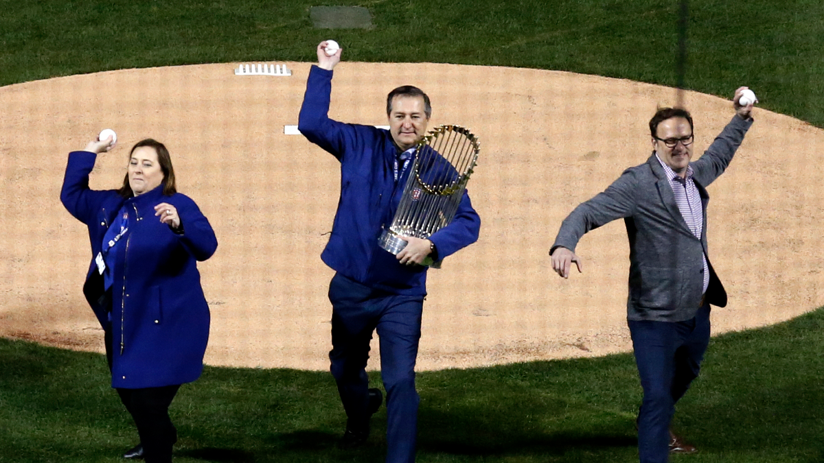 Laura Ricketts, left, Tom Ricketts, center, and Todd Ricketts throw the ceremonial first pitch. (AP Photo/Nam Y. Huh)