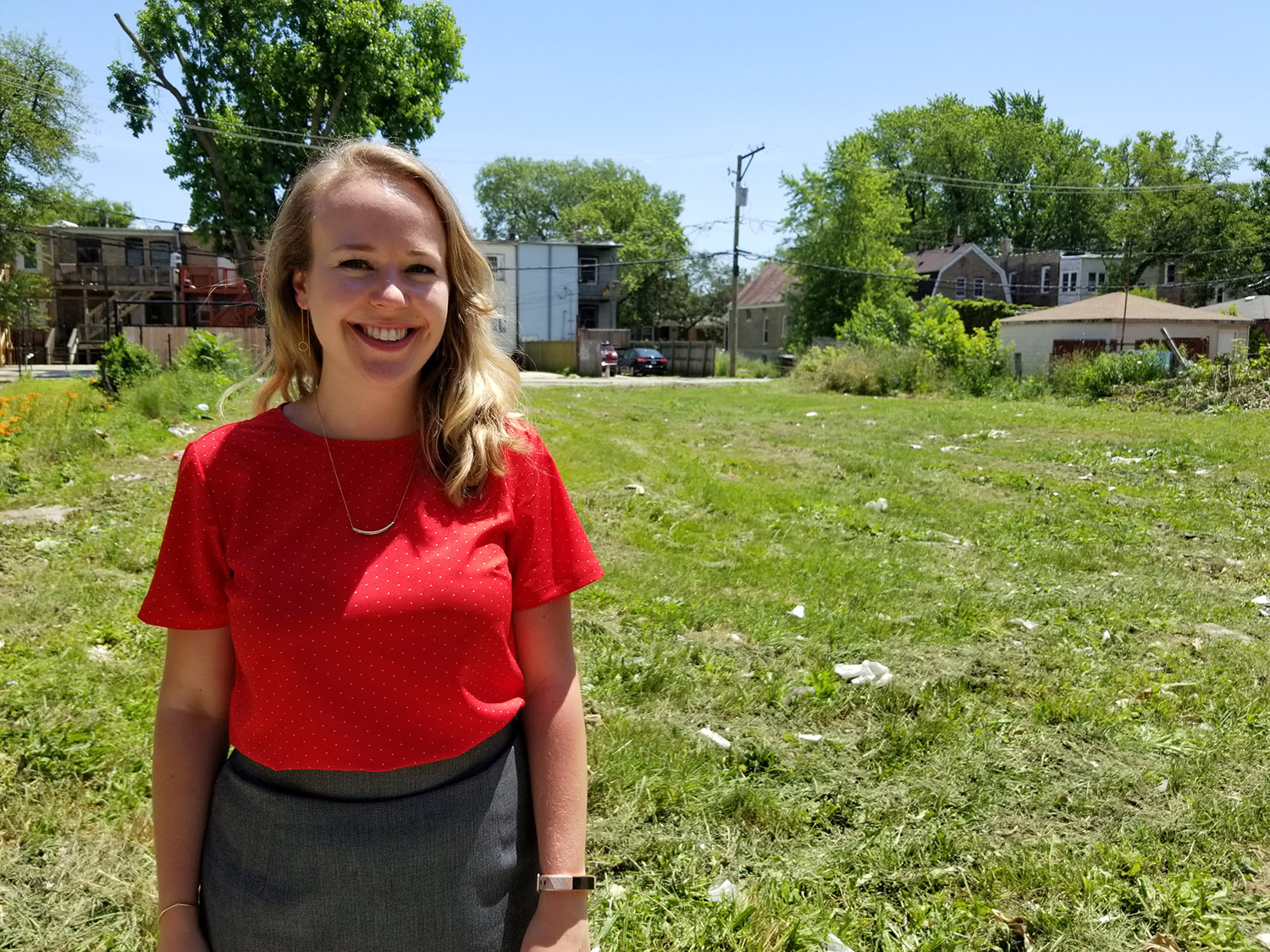 Sarah Brune, manager of innovation and public policy with Neighborhood Housing Services, stands in a vacant lot on the Chicago's West Side where the winning entry will be built. NHS is one of the affordable housing groups sponsoring the contest.