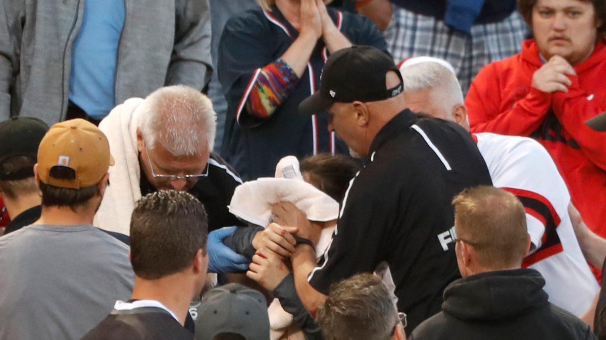 Emergency personal hold a towel on the face of a woman who was struck by a line drive by the White Sox's Eloy Jimenez during a June 10 game at Guaranteed Rate Field.
