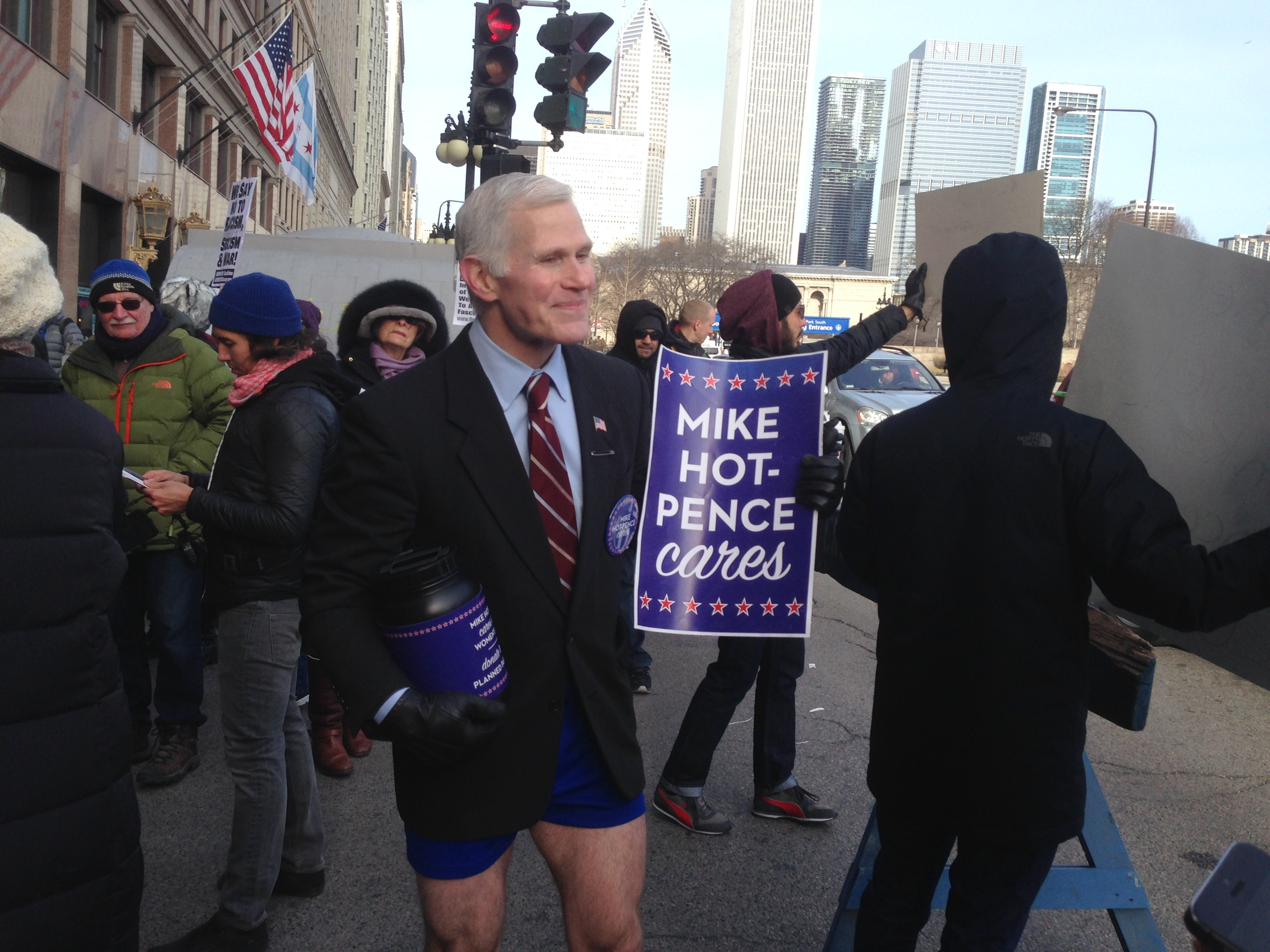 Glenn Pannell, a graphic designer from New York City, dresses as 'Mike Hot Pence' to collect donations for the Natural Resources Defense Council and other groups. On Friday, he joined protestors outside of a Republican fundraiser in Chicago. (Dan Weissmann/WBEZ)