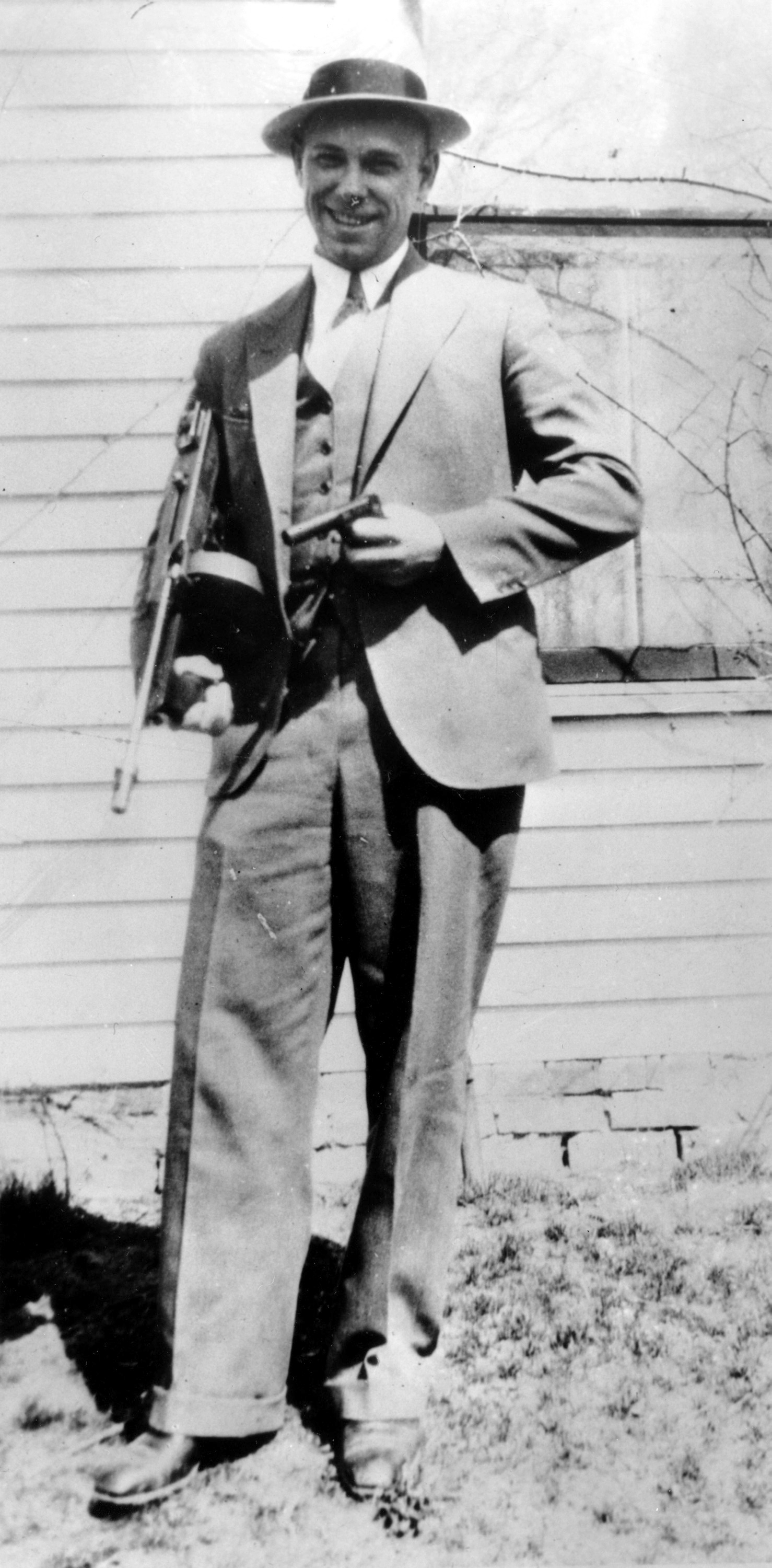 This is a 1934 file photo of desperado John Dillinger near Moore, Ind.