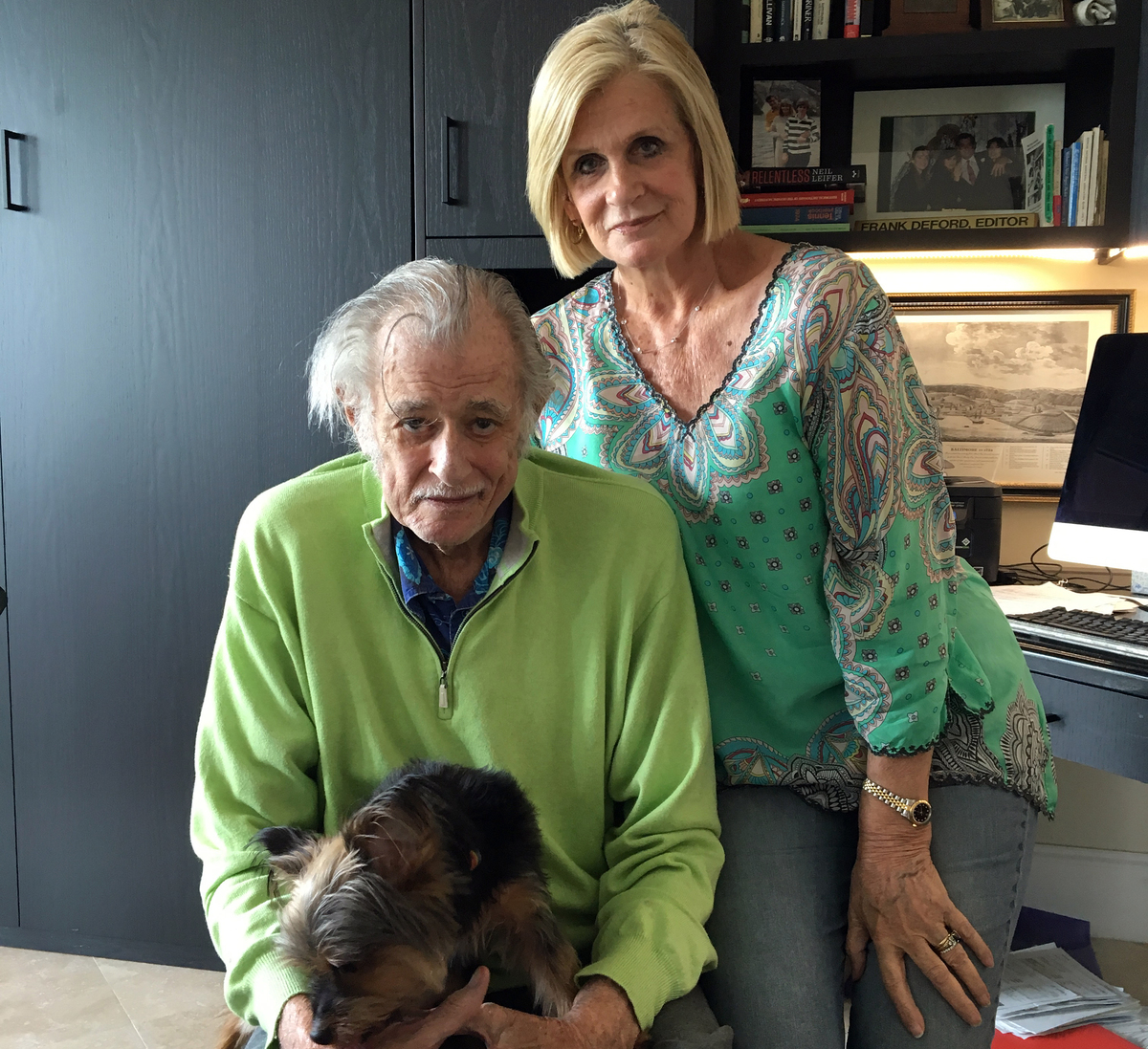 Frank Deford, his wife, Carol, and their dog, Miss Snickers, in his home office in Key West, Florida. On Wednesday, Deford retired from Morning Edition as sports commentator. (Tom Goldman/NPR)