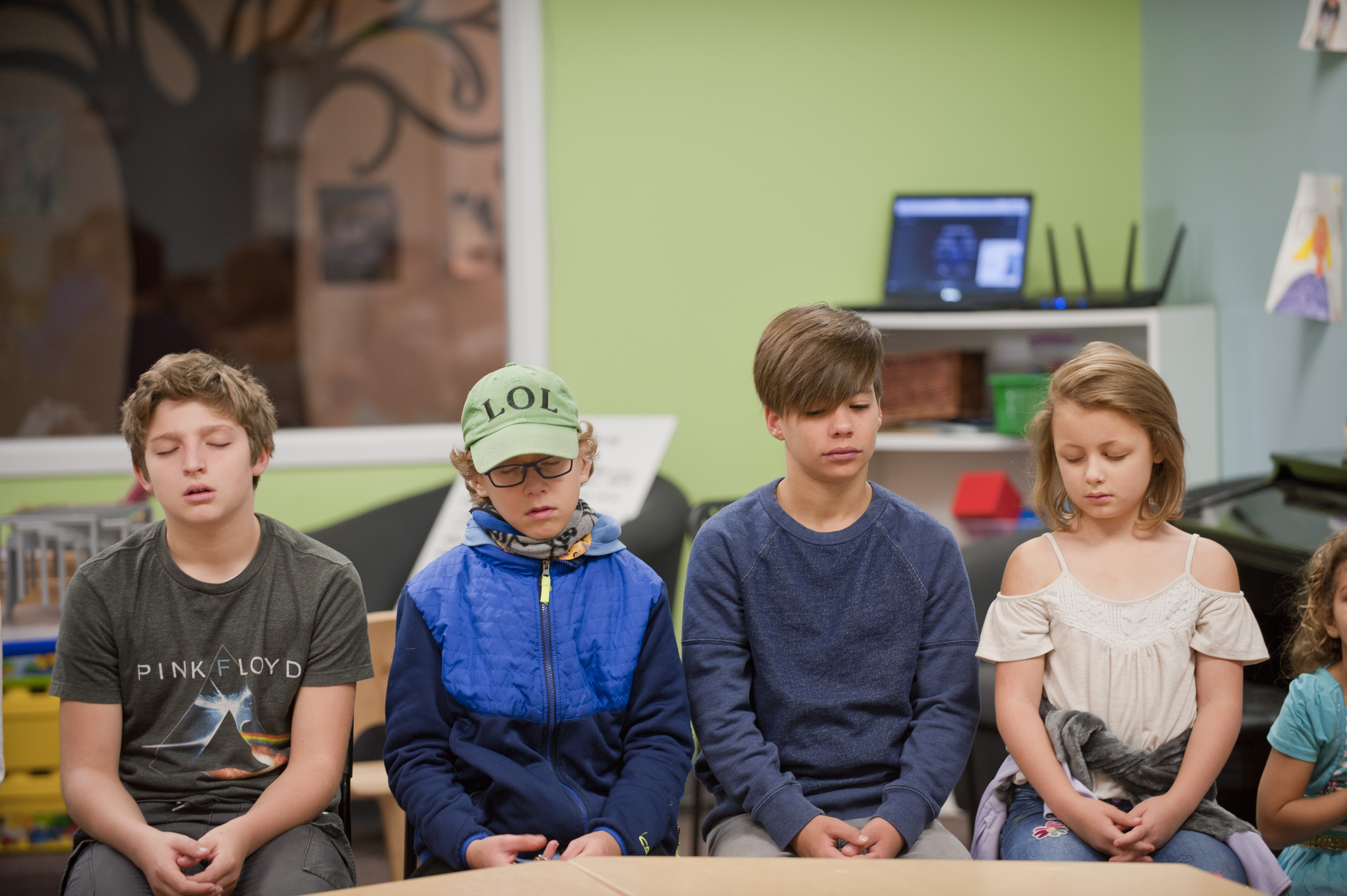 Students close their eyes during a mindfulness meditation on a recent day at Greenfields Academy. (WBEZ/Bill Healy)