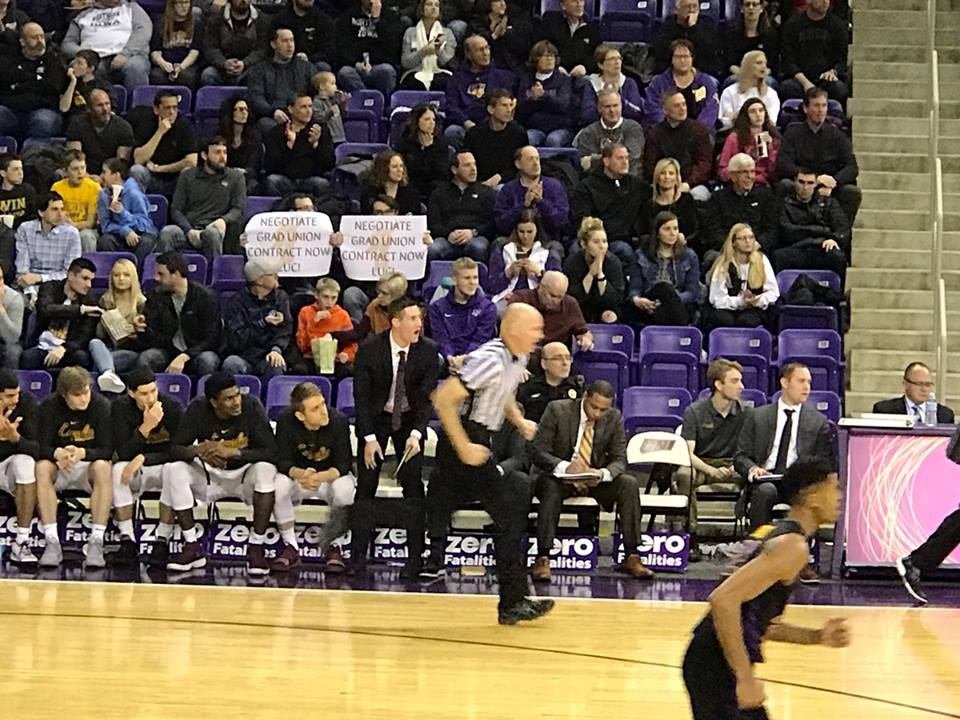 Loyola graduate student workers are getting creative as they try to pressure university administrators to negotiate, including protesting at a recent basketball game. (Photo courtesy of the Loyola Worker Coalition Facebook page)