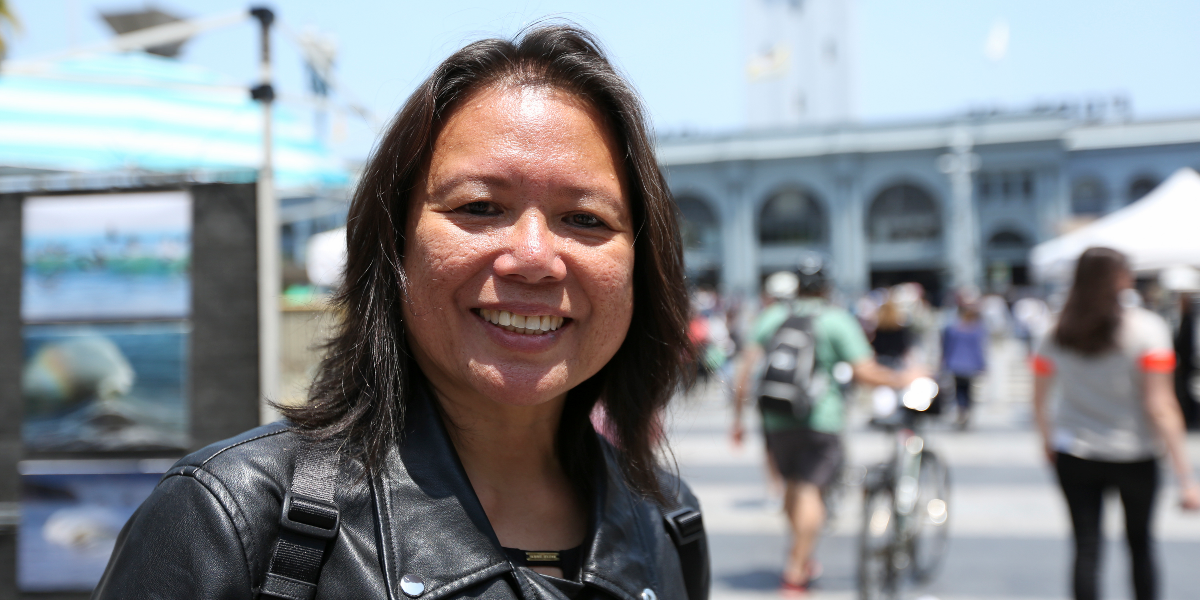 Mary Saunders, 53, stands outside of the Ferry Building in San Francisco, on July 3, 2018. 'As an immigrant and naturalized American citizen, it's something I have the privilege to participate in' said Saunders, a scientist and Brentwood resident who is originally from the Philippines. 'It's a day of celebration to stop and enjoy togetherness with family.' (AP Photo/Lorin Eleni Gill).