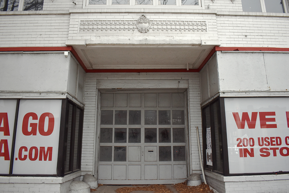Intricate carvings sit above the building's garage door.