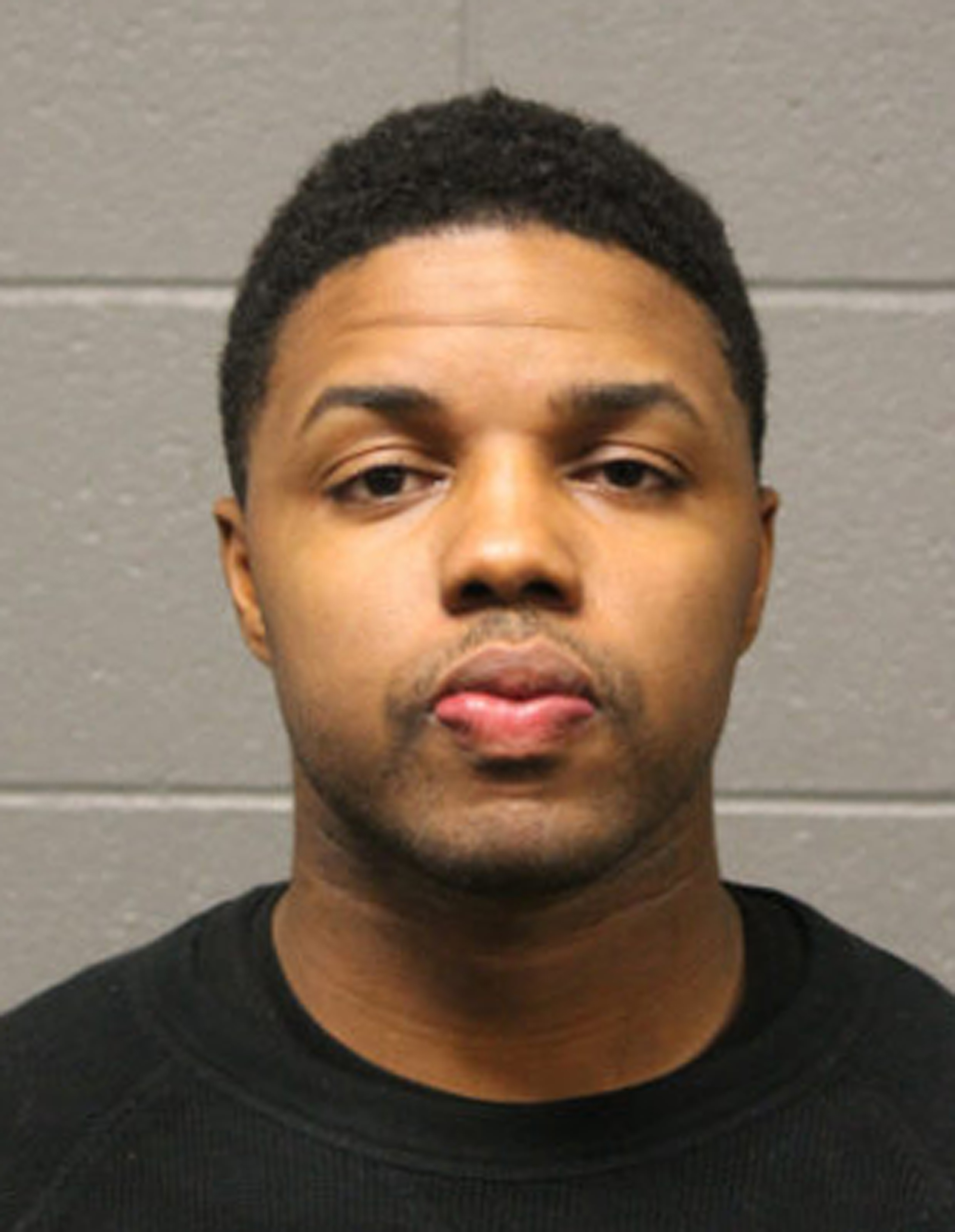This undated photo provided by the Chicago Police Department shows LaRoyce Tankson. Prosecutors have charged Tankson, an Amtrak police officer, with first-degree murder in the shooting death of a Minneapolis man, Chad Robertson, outside Chicago's Union Station. (Chicago Police Department via AP).