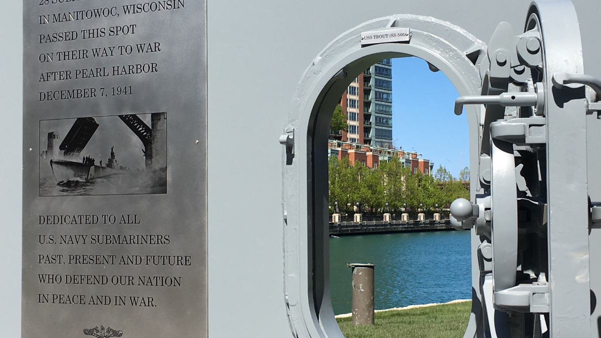 A view of the Chicago River through a submarine door at the memorial on the Chicago Riverwalk.