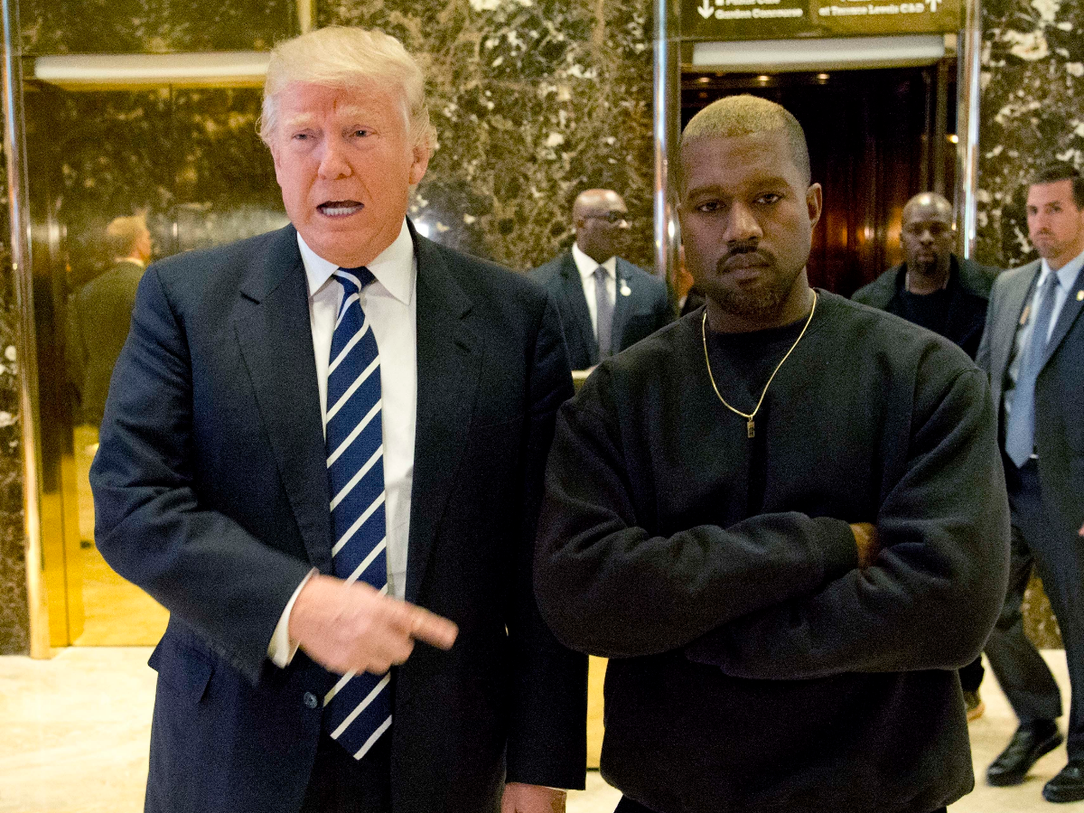 In late 2016, President-elect Donald Trump and Kanye West pose for a picture in the lobby of Trump Tower in New York. (AP Photo/Seth Wenig)