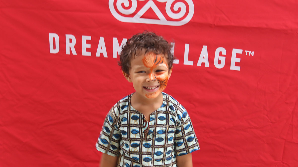 Uriah Amerik, 5, shows off his lion face paint. (Arionne Nettles/WBEZ)
