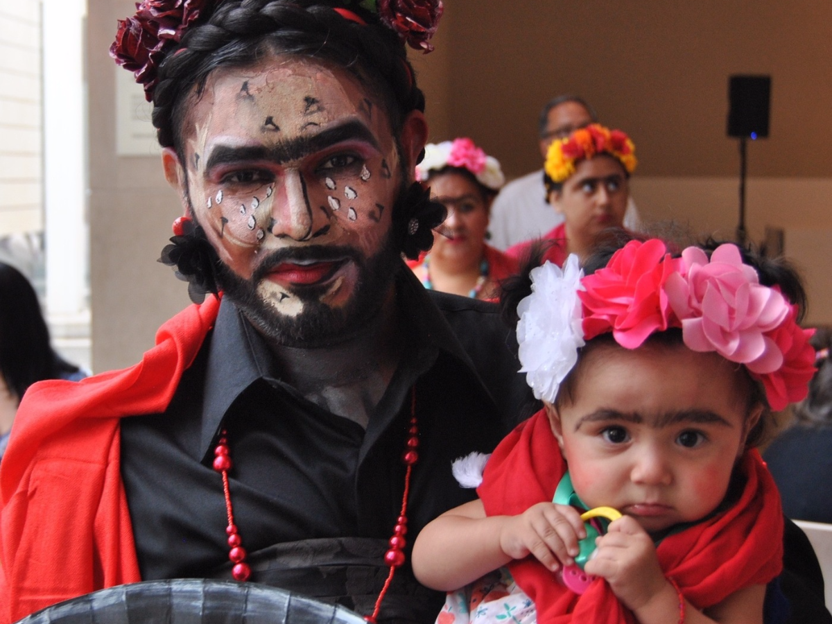 Marco Saucedo and his niece Anna Mata were among the hundreds of Frida fans participating in a Guinness World Records attempt for the most people dressed as the Mexican artist. (Miguel Perez/KERA)