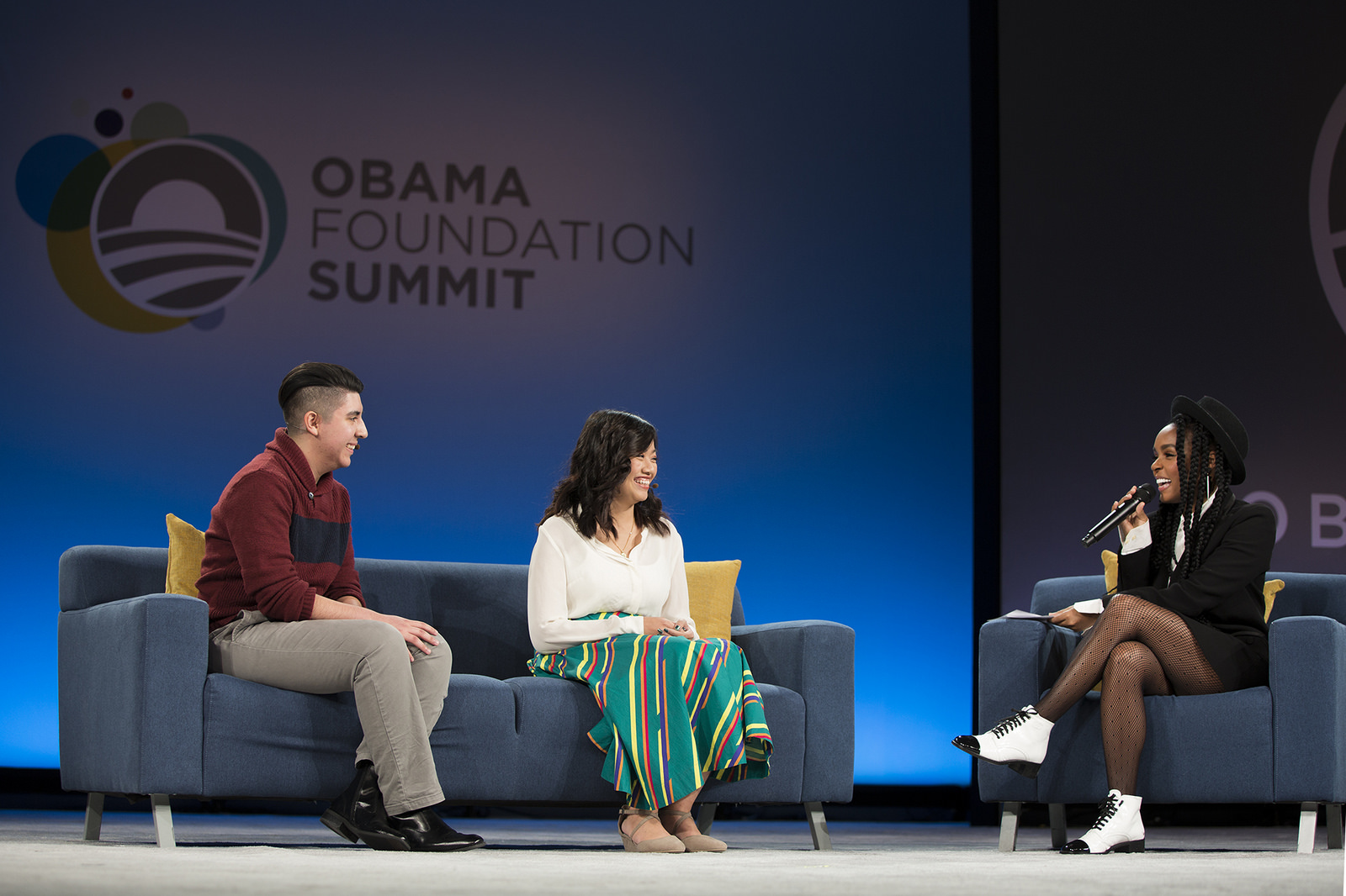 Singer and actress Janelle Monáe speaks with Community Leadership Corps members Anna Dong and Danny Flores. (The Obama Foundation)