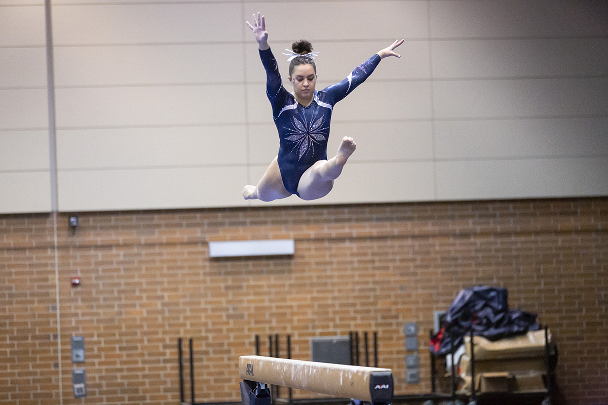 Senior Jenna Squillo on the balance beam.