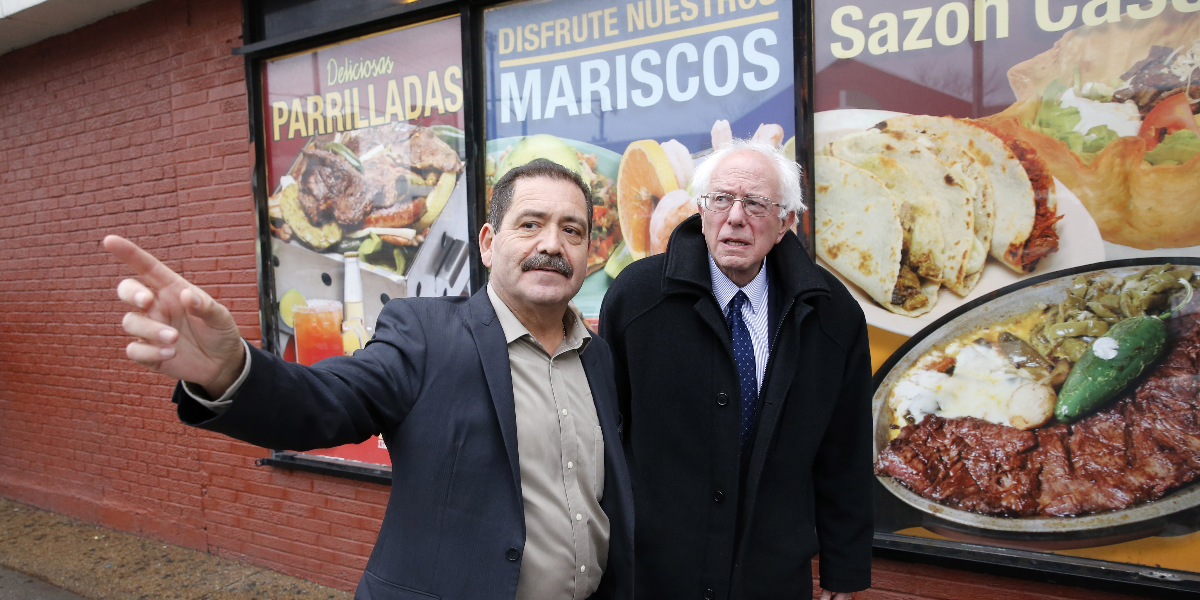 Democratic presidential candidate Sen. Bernie Sanders, I-Vt., right, visits Chicago's Little Village neighborhood where he attended a gathering hosted by Cook County Commissioner Chuy Garcia, left, Wednesday, Dec. 23, 2015, in Chicago. (Charles Rex Arbogast/AP)