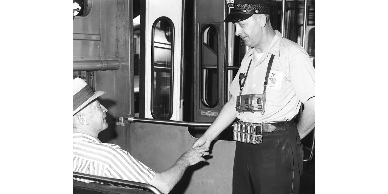 Before 1997, each CTA train had a conductor in addition to an operator. Here, a conductor accepts fares on board a train on the Ravenswood Line (now the Brown line) in 1964. (Courtesy CTA)