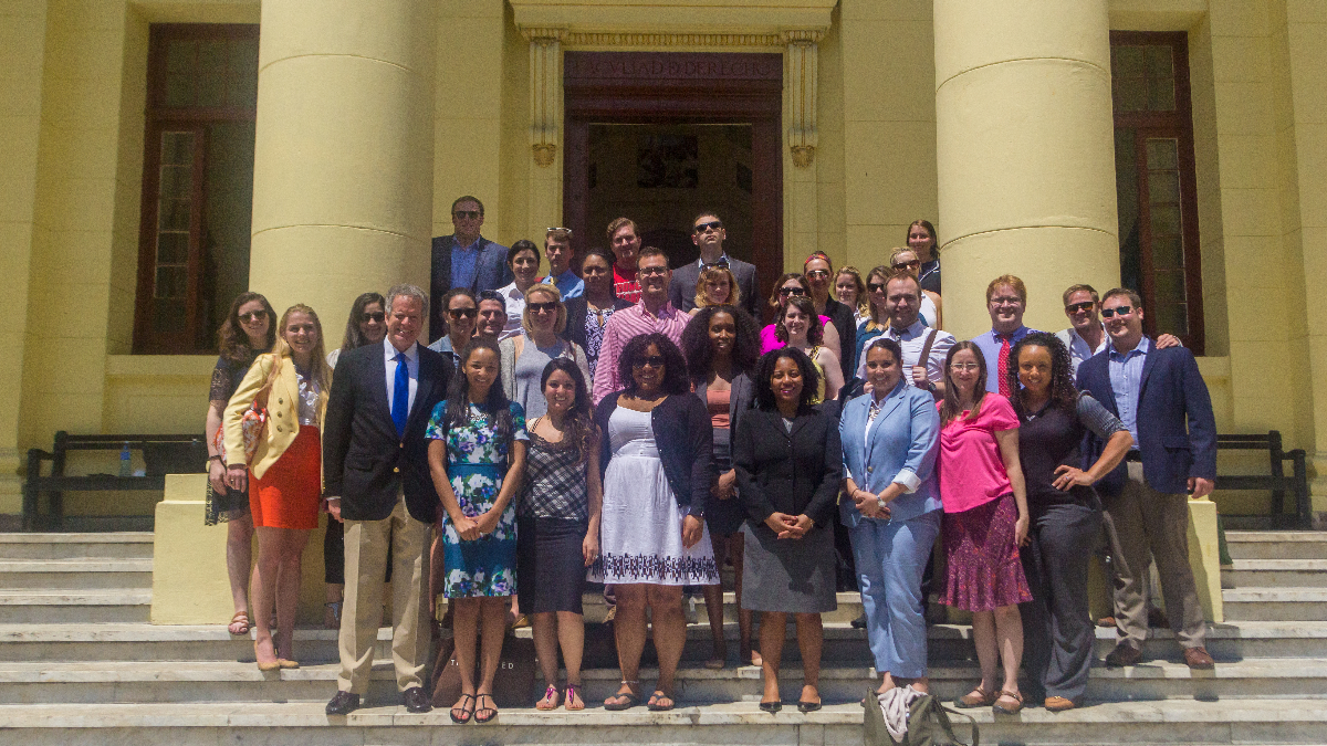 DePaul Law Professor Alberto Coll (front row first from left), with DePaul students in front of the University of Havana Law School where his mother and Fidel Castro studied together. (Julian Hayda/WBEZ)
