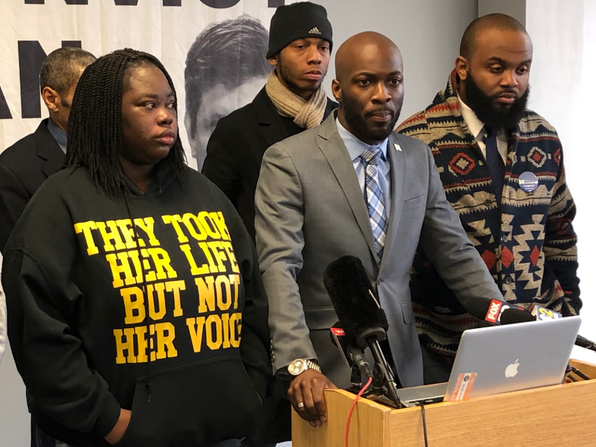 Activist Jedidiah Brown speaks Thursday, flanked by Camiella Williams, Lamon Reccord, and Will Calloway. The group of activists said a new Toni Preckwinkle ad is a 'slap in the face.' (Patrick Smith/WBEZ)