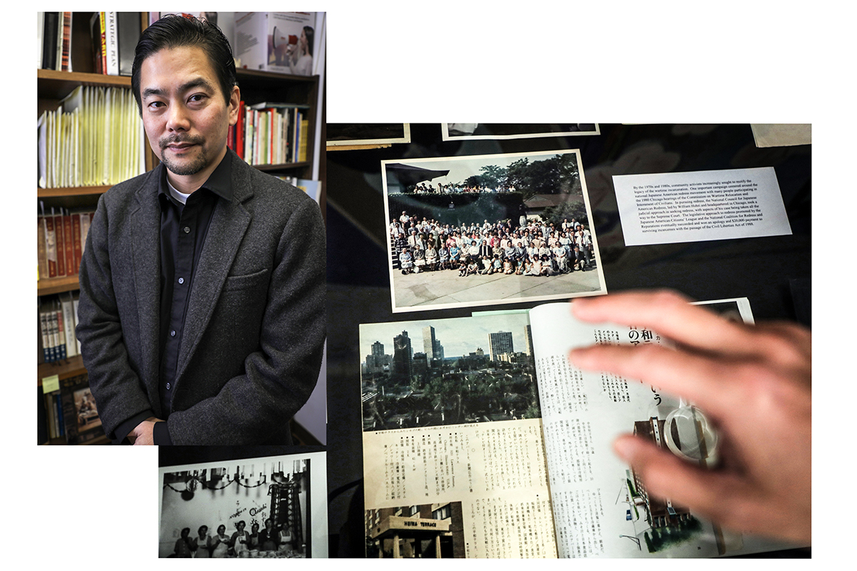 Ryan Yokota, left, of the Japanese American Service Committee in Chicago. He points to images and documents that mark milestones in Chicago's Japanese-American community. (Ambriehl Crutchfield/WBEZ)