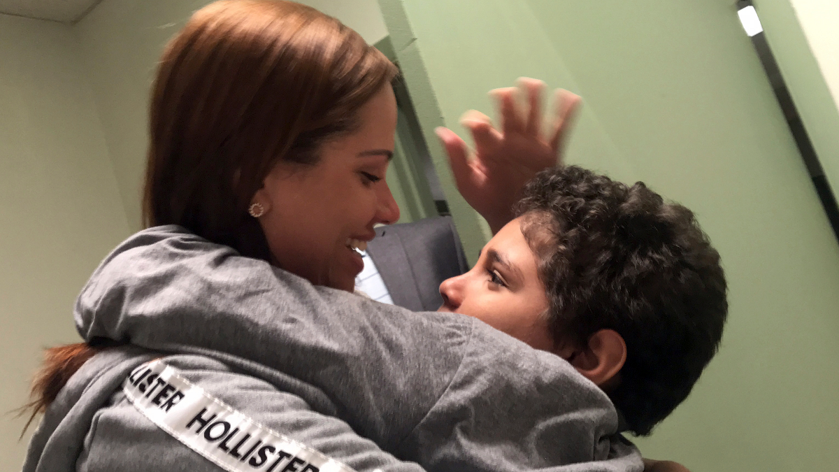 In this Tuesday, June 26, 2018 photo provided by paralegal Luana Mazon, Lidia Karine Souza, 27, hugs her 9-year-old son Diogo De Olivera Filho as Souza visited her son for the first time since they were separated at the U.S.-Mexico border in late May. Her son remained in custody, much of it quarantined in a room because he had the chicken pox, and she has been told the soonest the boy could be released is late July. She filed a lawsuit against the Trump administration. An emergency hearing is scheduled for Thursday. (Courtesy of Luana Mazon via AP)