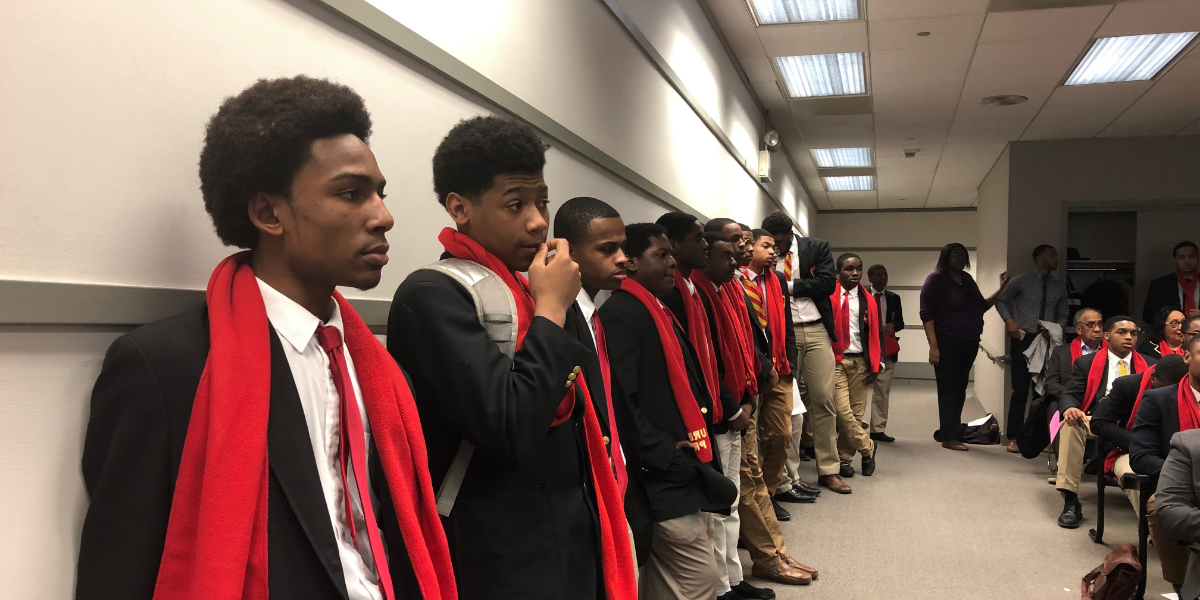 Students from Chicago's Urban Prep West charter school attend an Illinois State Charter School Commission hearing in March 2019. They were successful in their fight to keep their school open.