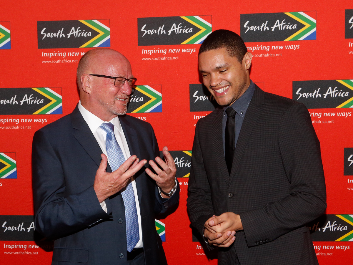 Trevor Noah, right, with South Africa's Minister of Tourism, Hon. Derek Hanekom, at South African Tourism's Ubuntu Awards in April 2015 in New York. (Photo by Jason DeCrow/Invision for South African Tourism/AP Images)
