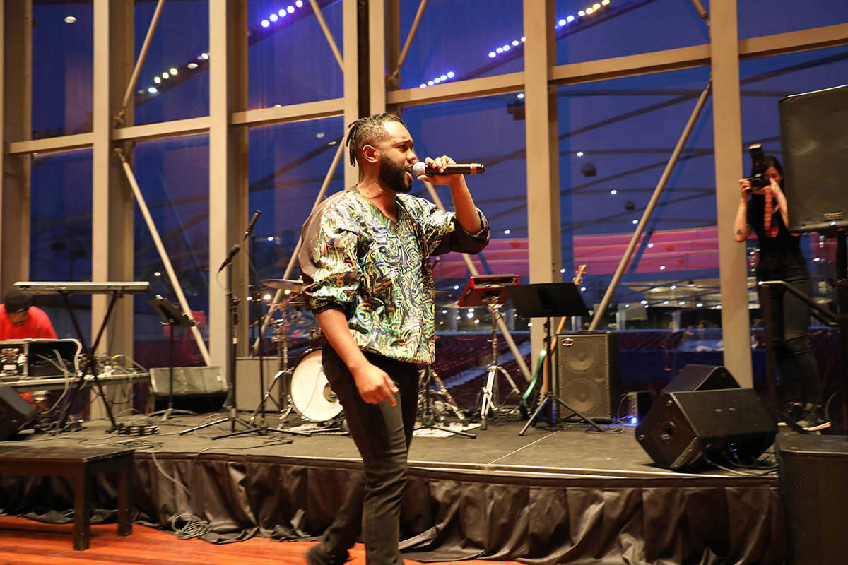 Rapper and poet Mykele Deville, who is also a teaching artist for Envisioning Justice, performs at the event. (Arionne Nettles/WBEZ)