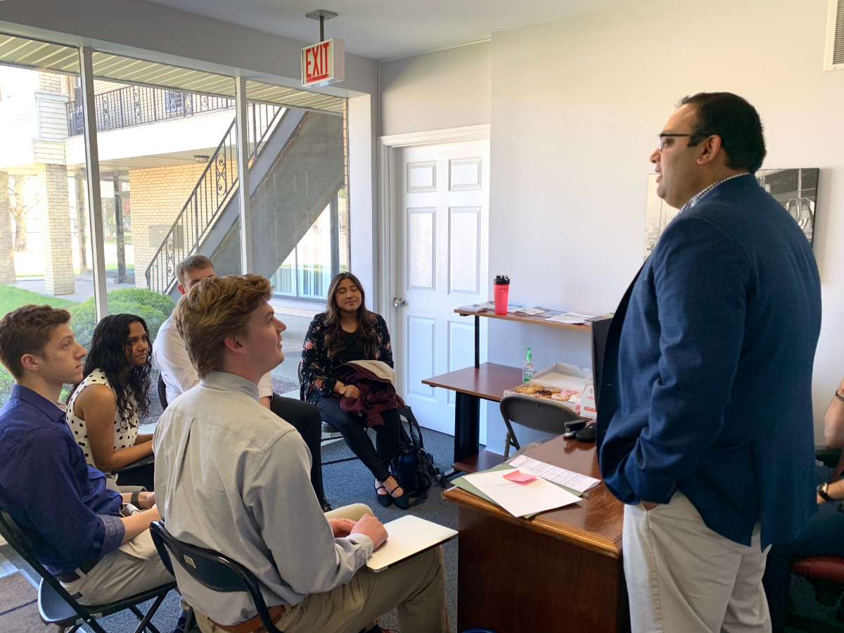 State Sen. Ram Villivalam (D-Chicago), right, speaks to interns at his district office on May 13, 2019. Villivalam is Illinois' first Asian American state senator.