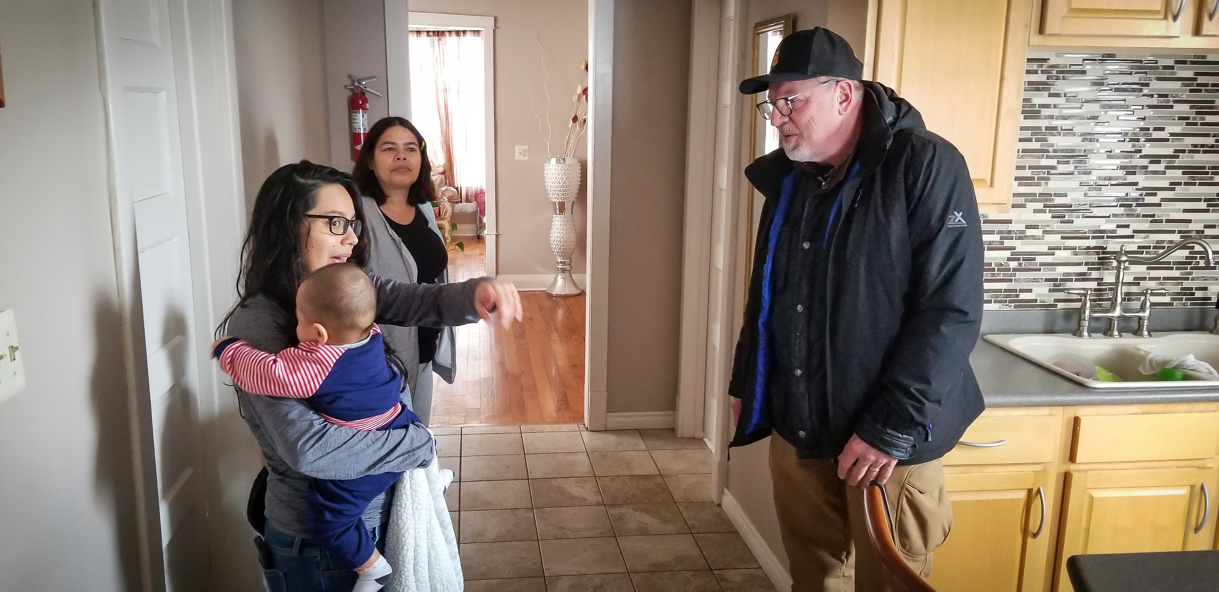 Harry Meyer visits his childhood home in Gage Park and talks with Beatriz Arzate and her family, who live in the home today. In 1970, the entire Southwest Side was considered middle income. Today, average incomes in the area are far under what UIC researchers consider