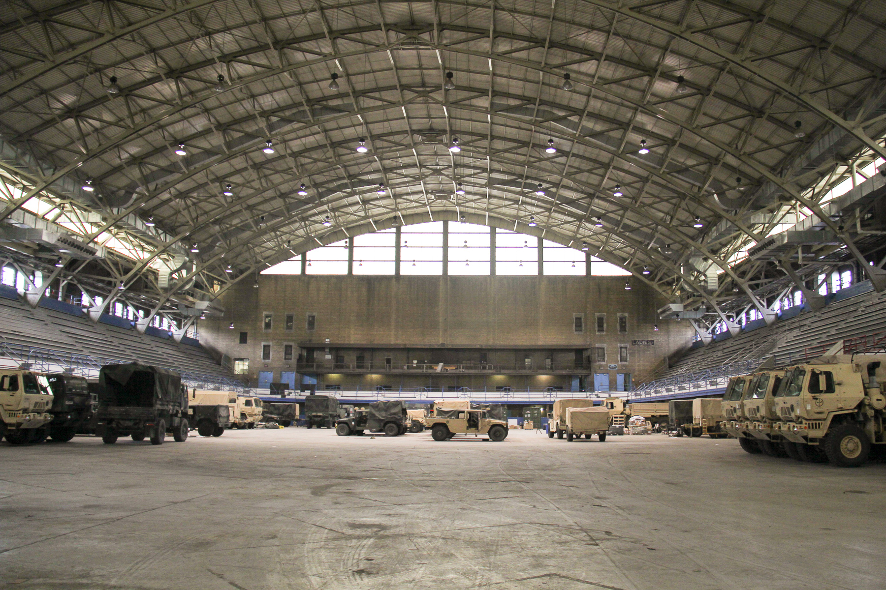 Military vehicles currently occupy the large arena at the General Richard L. Jones Armory in preparation for the 2nd Battalion 178th Infantry's deployment to Afghanistan this month.
