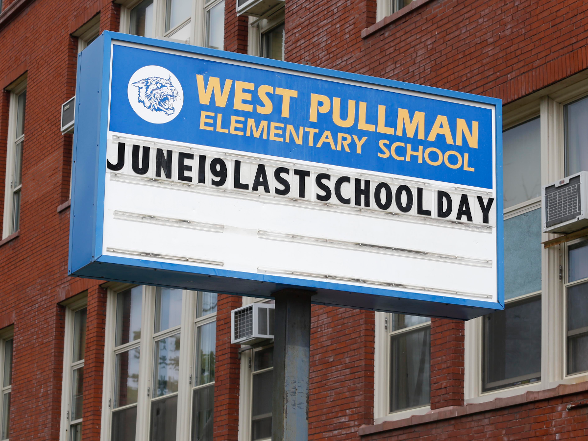West Pullman Elementary School marked its very last day with this sign in 2013. It closed as part of the largest mass closing of schools in the nation's history. (AP Photo/M. Spencer Green)