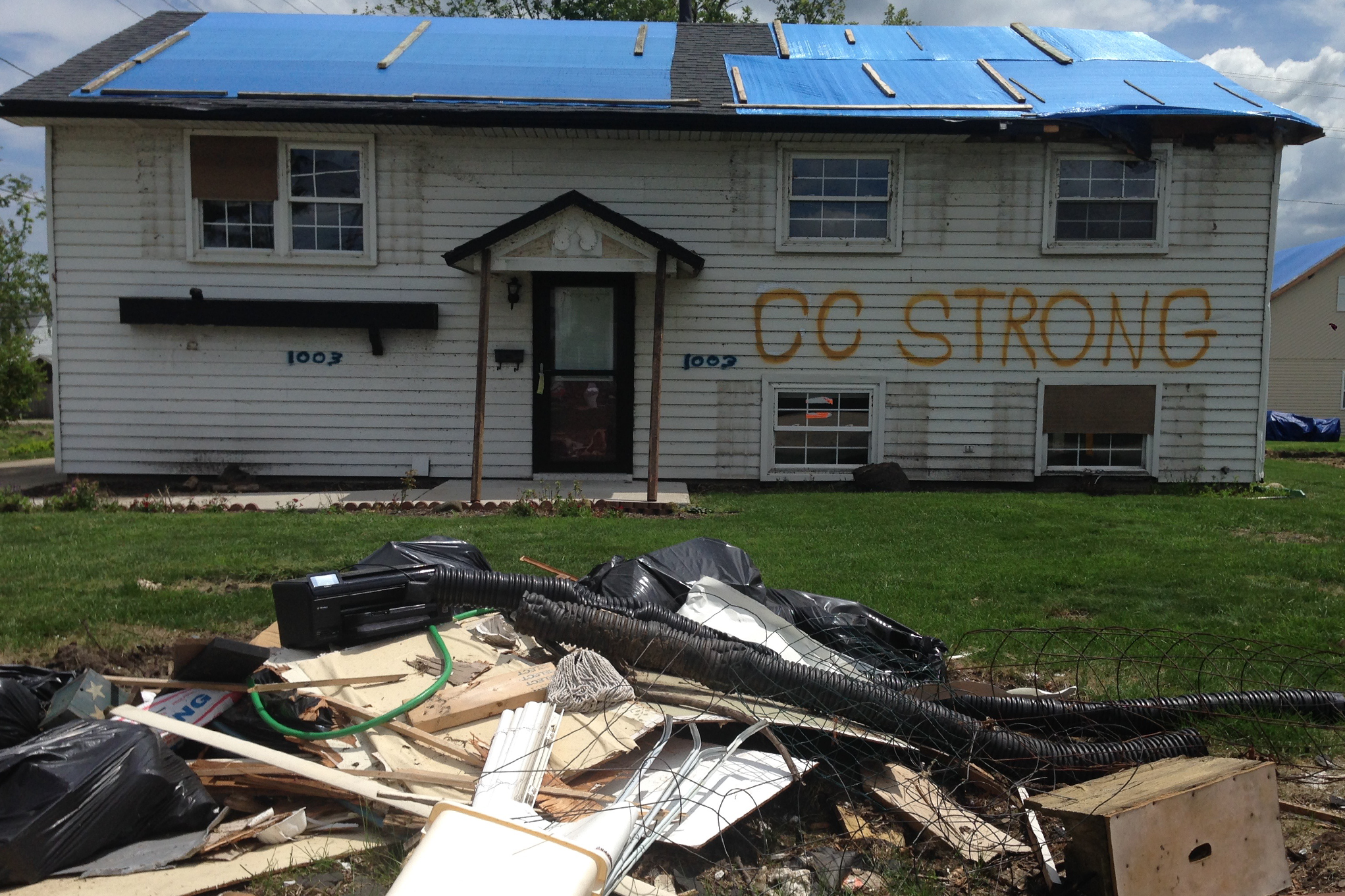 John and Suzanne Lissy's home right after the tornado in 2015. Their daughter spraypainted the phrase COAL CITY STRONG on their soon to be demolished home. (Yolanda Perdomo/WBEZ)