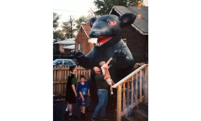 Ken Lambert, his two sons and a neighbor with the first Scabby the Rat balloon in Lambert's backyard in Chicago's Beverly neighborhood in 1991. (Courtesy Ken Lambert)