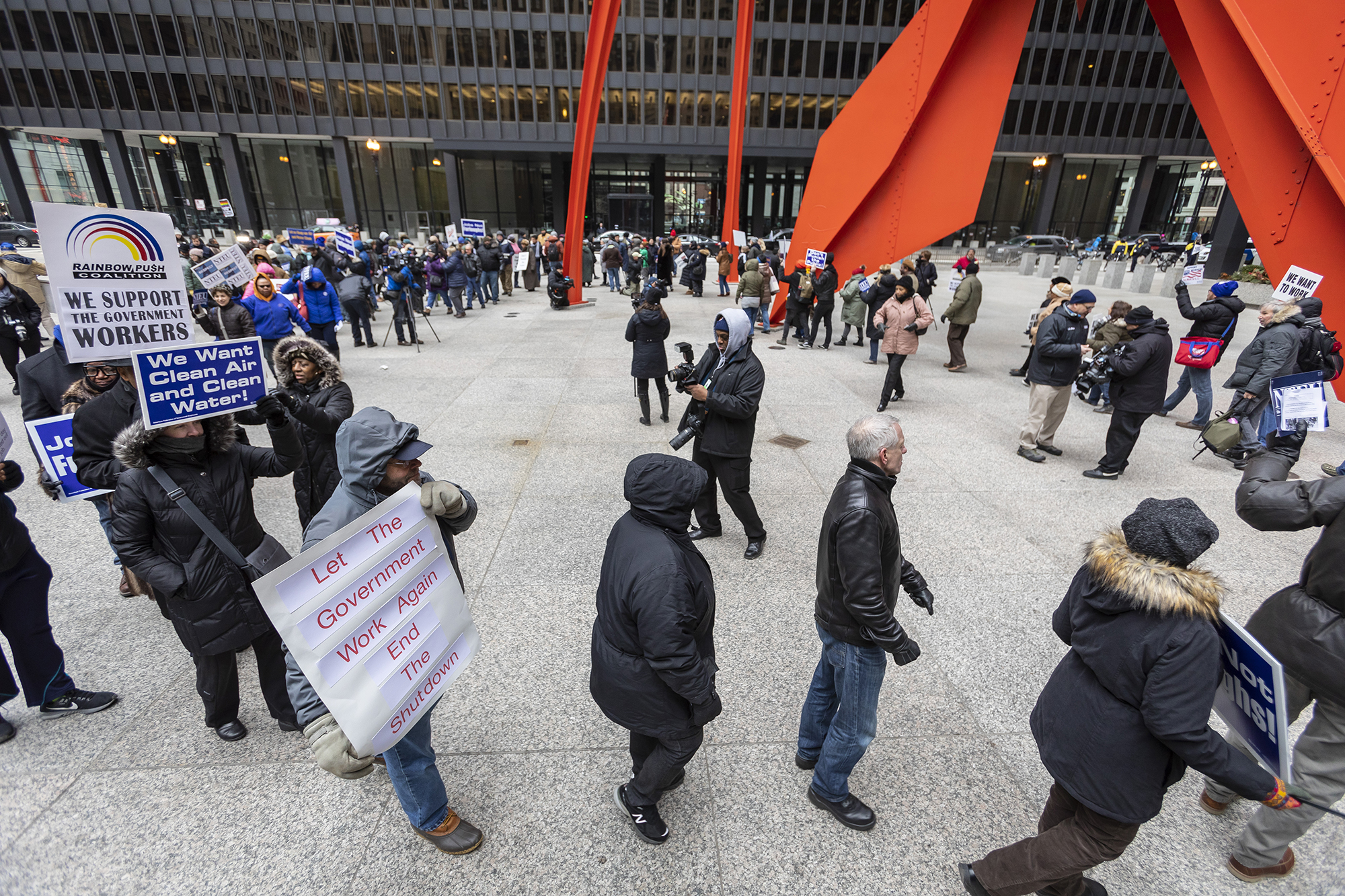 Despite the frigid temperatures, several dozen federal workers and labor leaders rallied to demand an end to the government shutdown. They said they will rally in downtown Chicago's Federal Plaza every Thursday at noon until the shutdown ends. (Manuel Martinez/WBEZ)