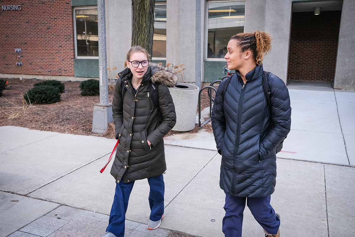 Gymnasts Maddie Nowak, left, and Miki Northern are both in the nursing program at UIC.