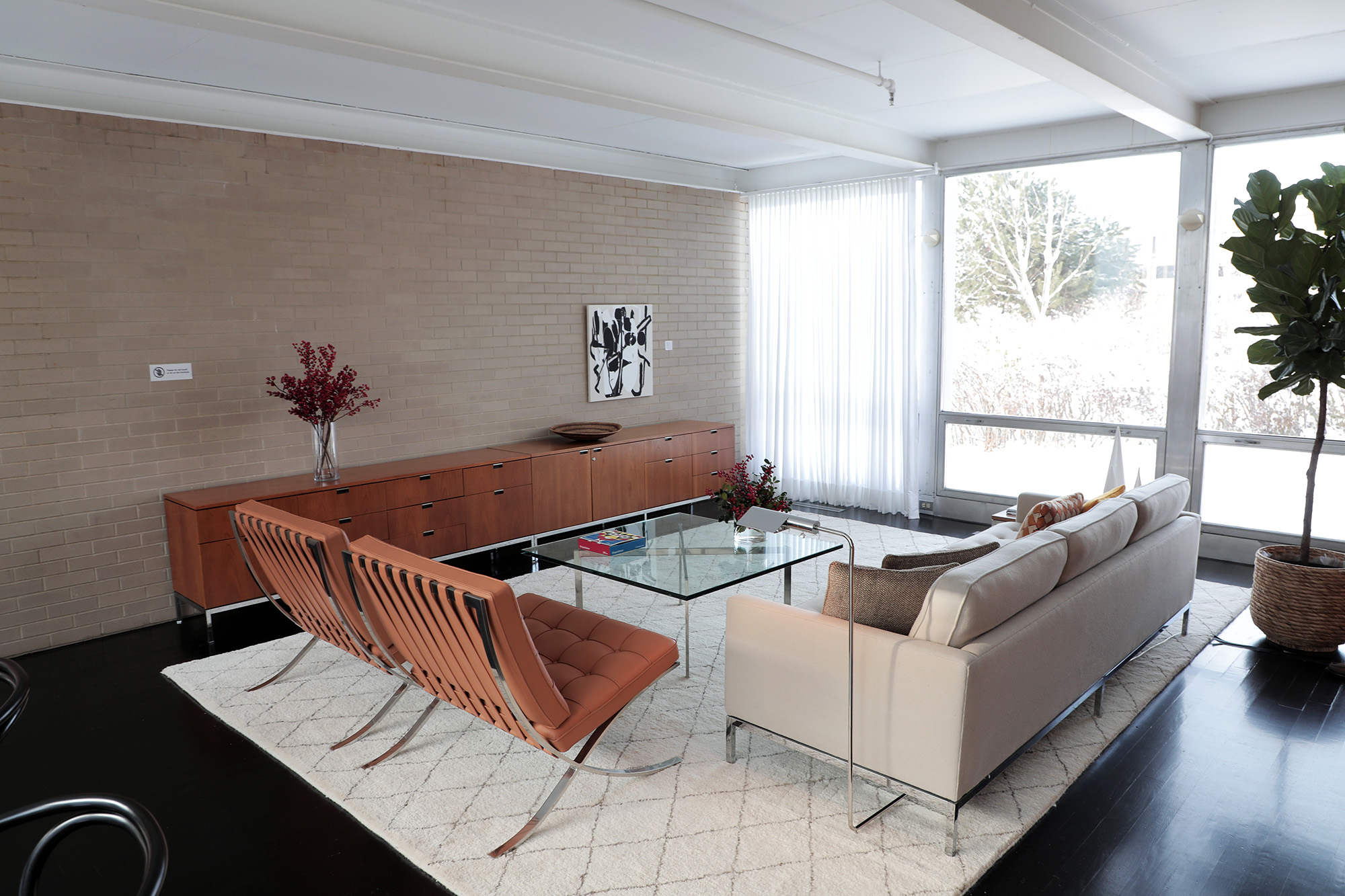 The glass coffee table is intentionally within arm's reach of the brown leather Barcelona chairs and couch. (Arionne Nettles/WBEZ)