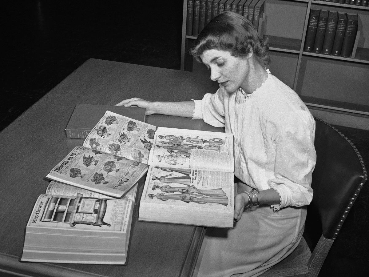 Librarian Ruth Parrington at the Chicago Public Library, studies early Sears Roebuck catalogs from 1902 that are in the library's collection. (AP Photo)