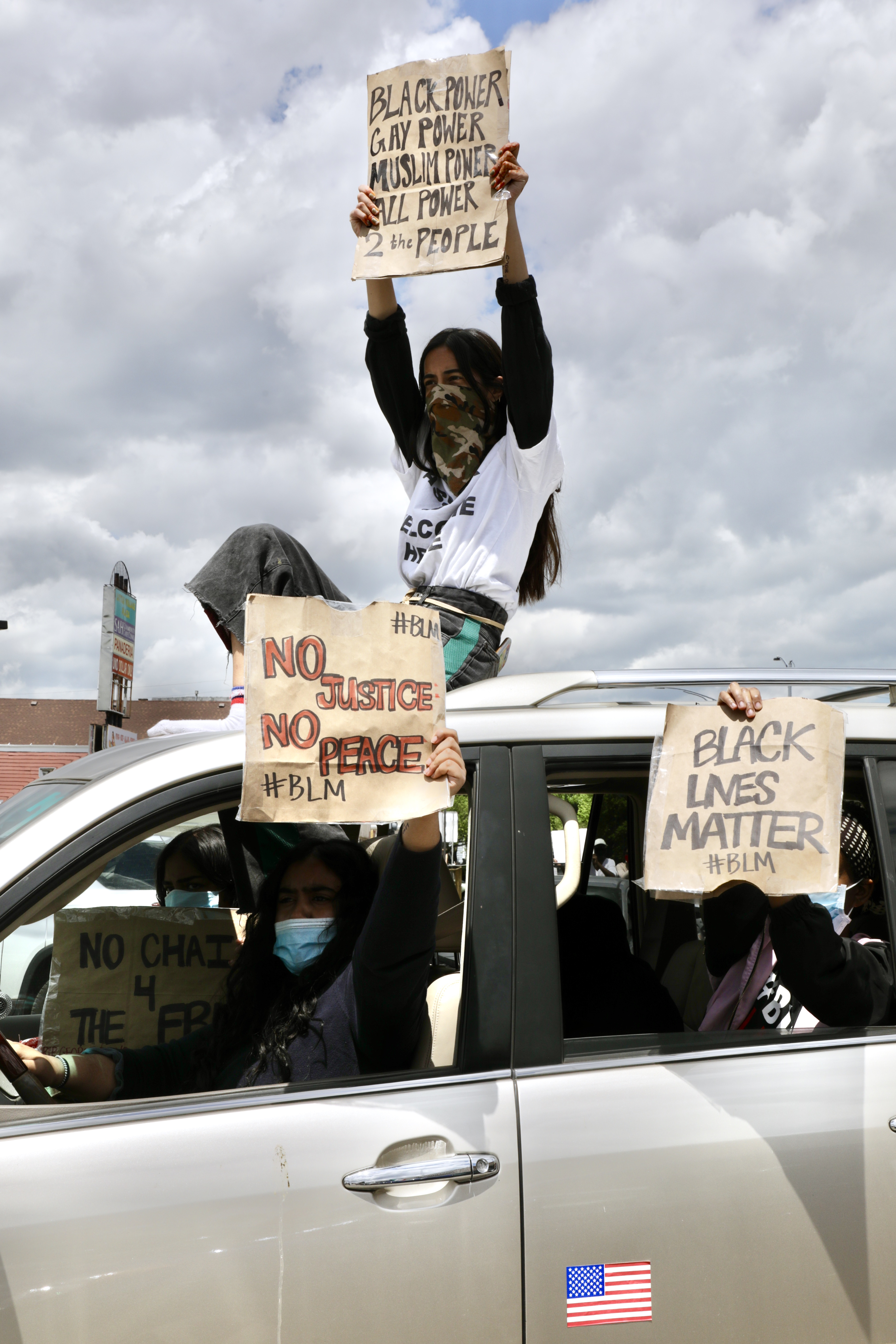 Holding signs out of cars