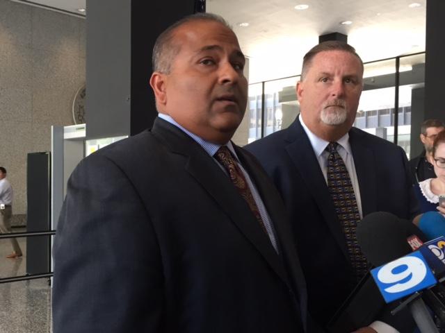 John Bills (right) stands next to attorney Nishay Sanan. (Susie An/WBEZ)