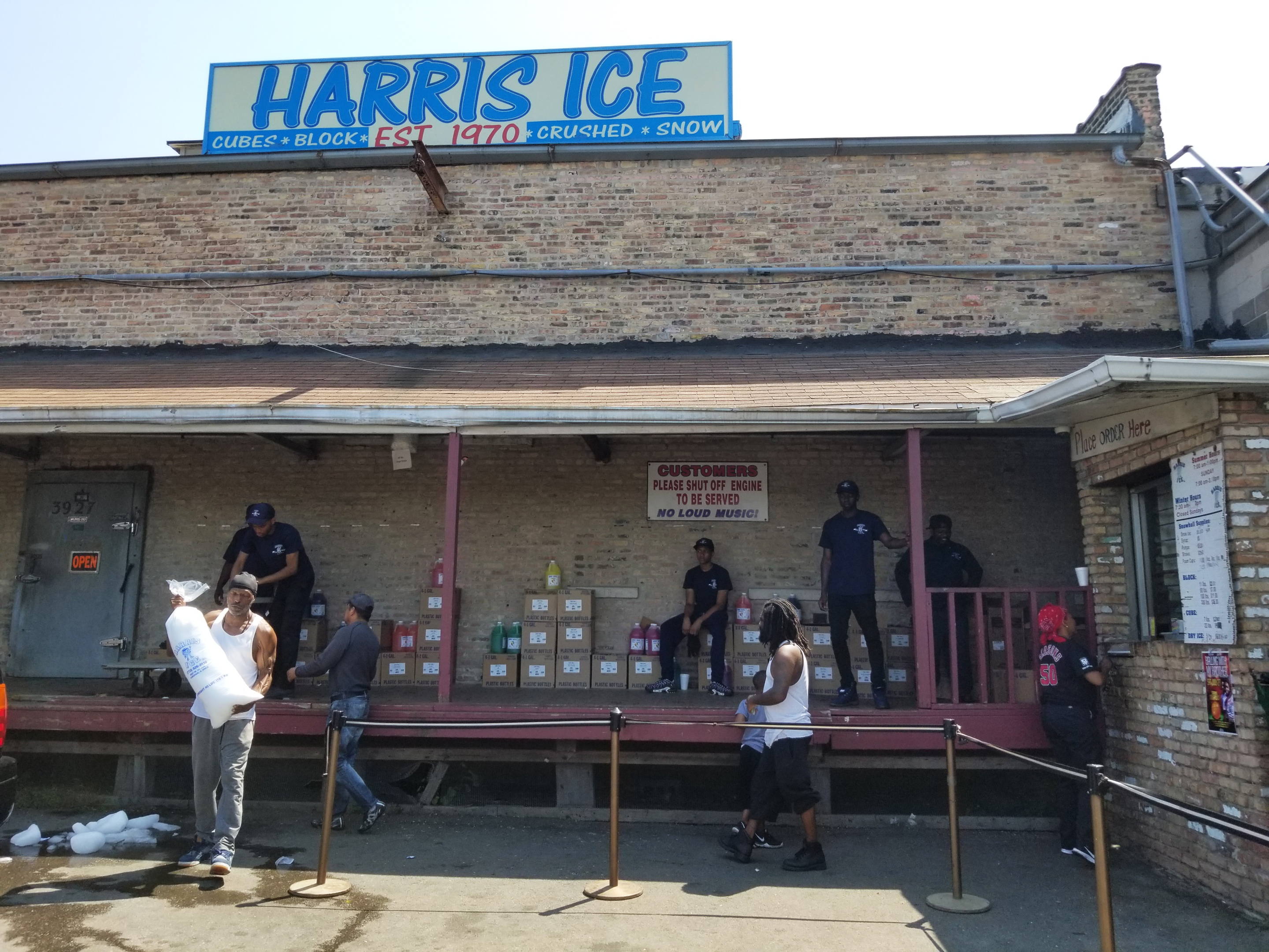 "Customers pick up &quotsnow ice"" at Harris Ice. Lots of West Side snow cone vendors get their main ingredient from the Fifth Avenue ice house."