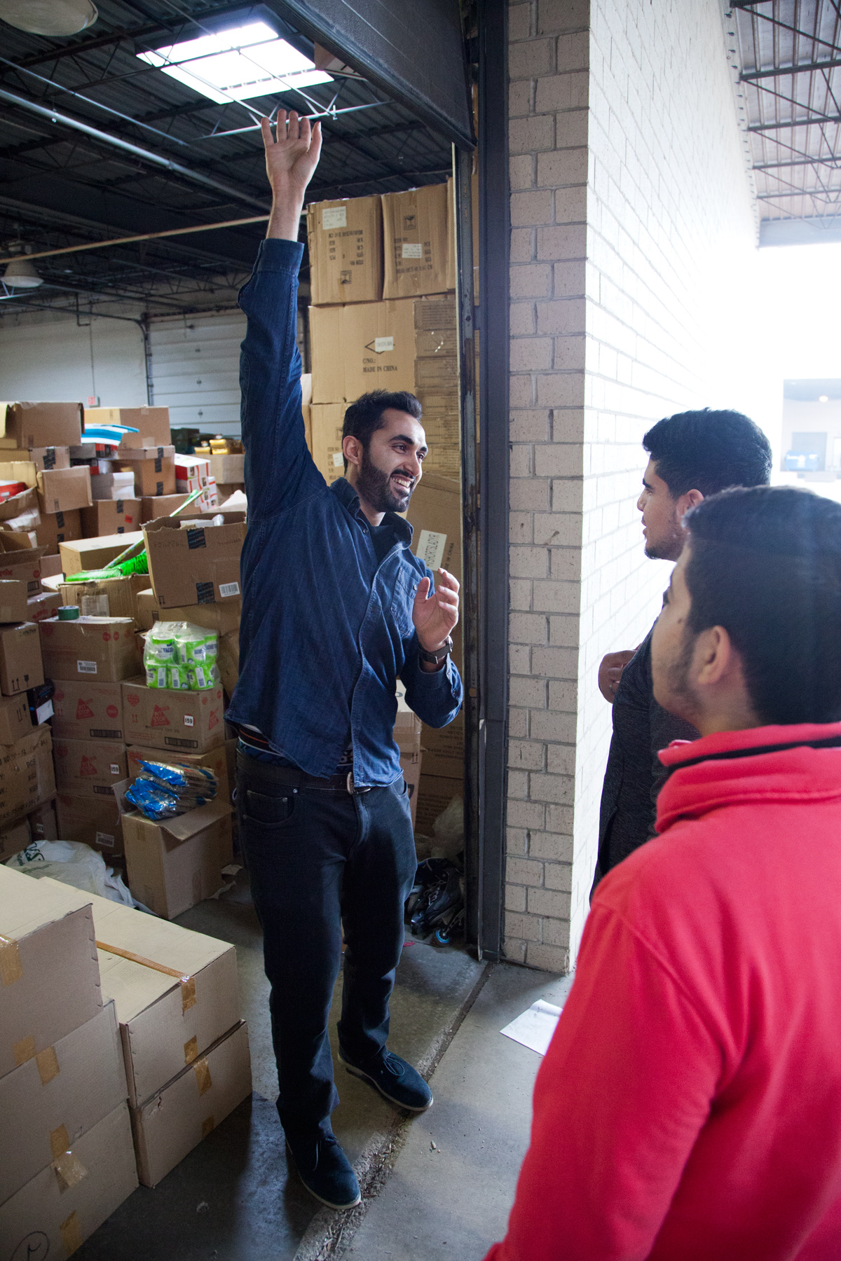 Almaleh at his import-export business. (Andrew Gill/WBEZ)