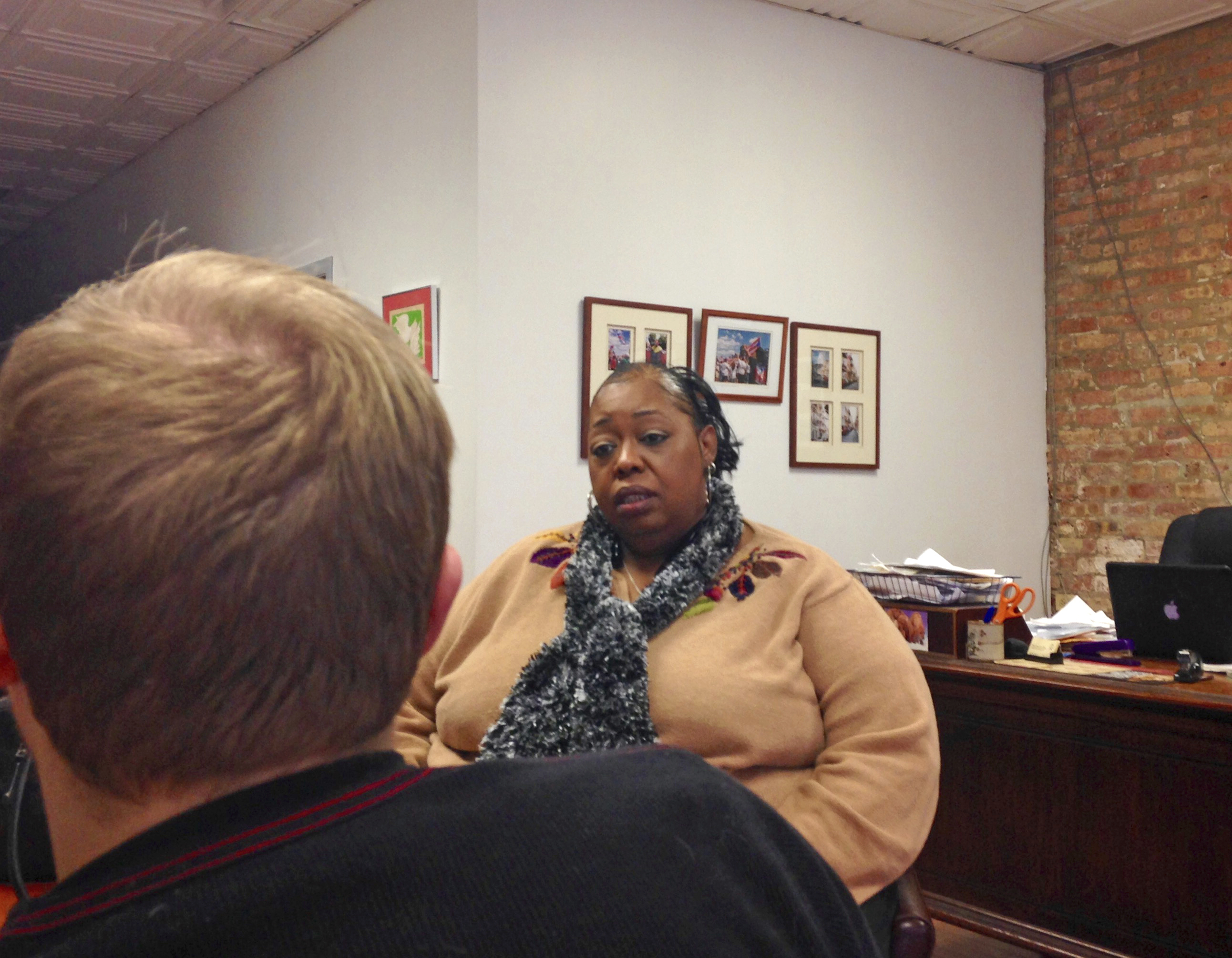 Lavette Mayes talks with Max Suchan, who co-founded the Chicago Community Bond Fund in Chicago, in December 2016. Mayes, was arrested for the first time after she got into a fight with her mother-in-law, spent more than a year in Cook County Jail unable to come up with $25,000 needed to post bond. (Sara Burnett/AP)