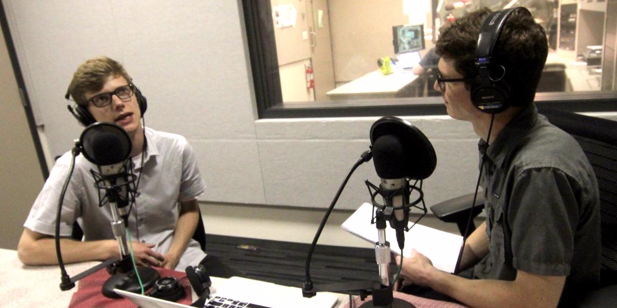 Questioner Will Bouman (left) speaks with WBEZ reporter Chris Hagan. (Jesse Dukes/WBEZ)