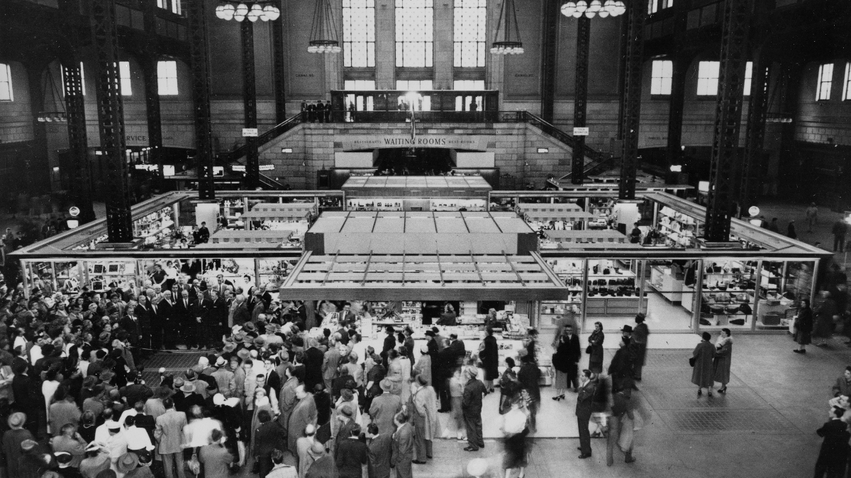 A crowd gathers for the ribbon cutting ceremony at the opening of the new Fred Harvey shopping center in the Chicago Union Station, the first of its kind in any transportation terminal, in Chicago, Ill., Feb. 20, 1956. (AP Photo).