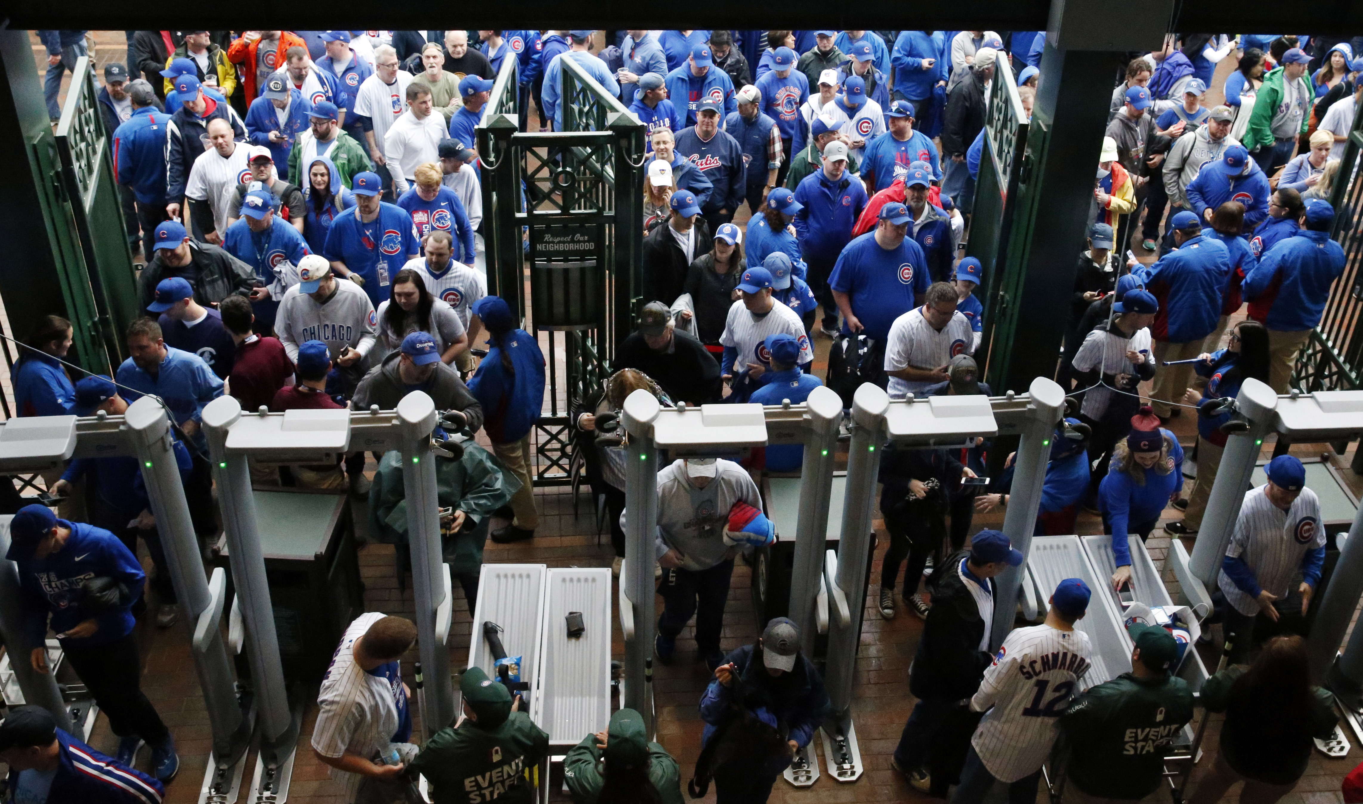 Fans line up outside Wrigley Field before the Cubs' home opener in Chicago. (AP Photo/Nam Y. Huh)