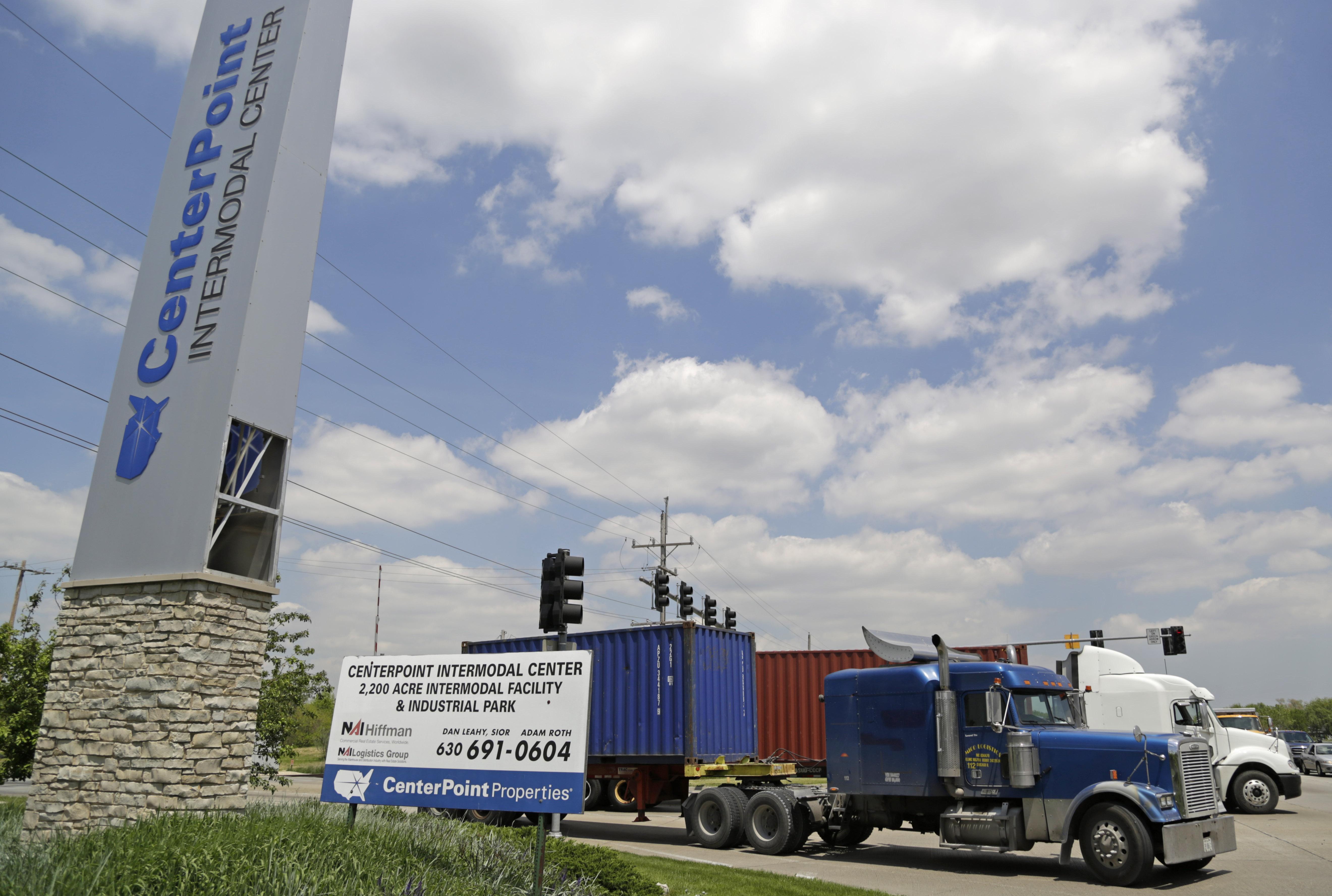 Trucks leaving the Center Point Intermodal Center outside Elwood on May 23, 2014. (M. Spencer Green/Associated Press)