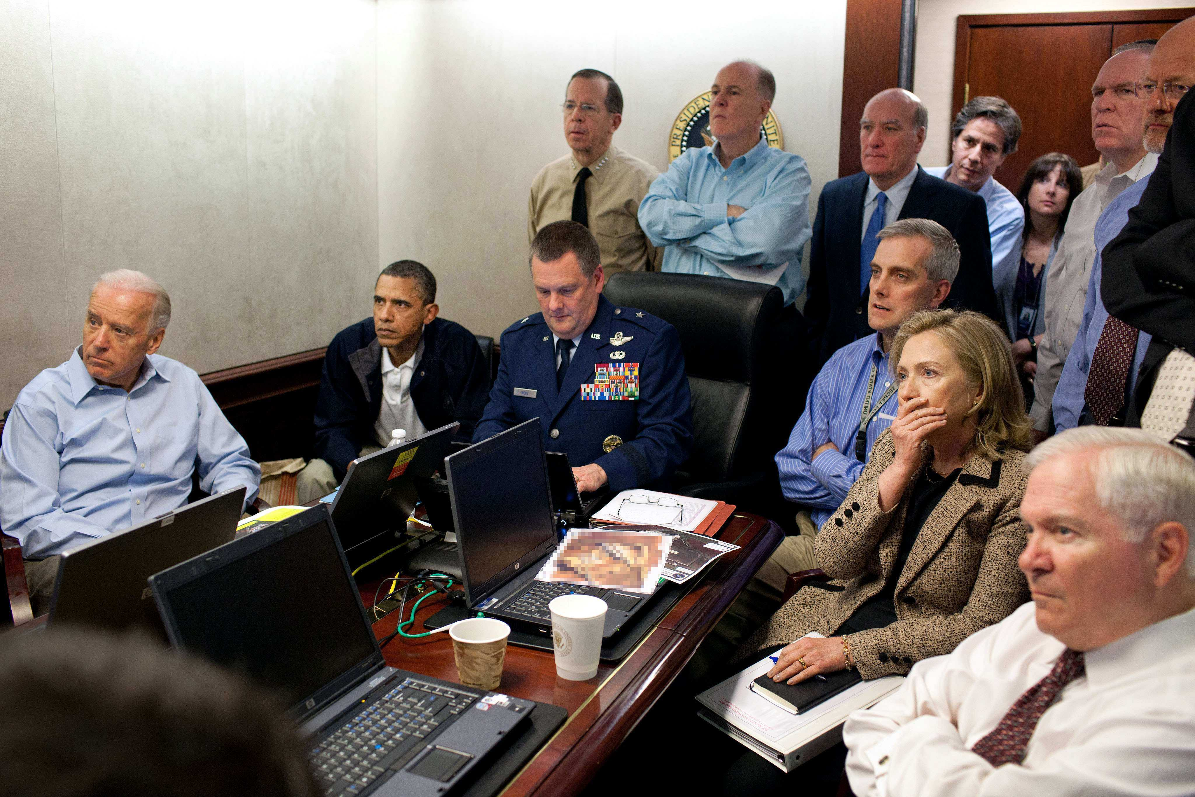 In this May 1, 2011 image released by the White House and digitally altered by the source to diffuse the paper in front of Secretary of State Hillary Rodham Clinton, President Barack Obama and Vice President Joe Biden, along with with members of the national security team, receive an update on the mission against Osama bin Laden in the Situation Room of the White House in Washington. (Pete Souza/The White House via AP)